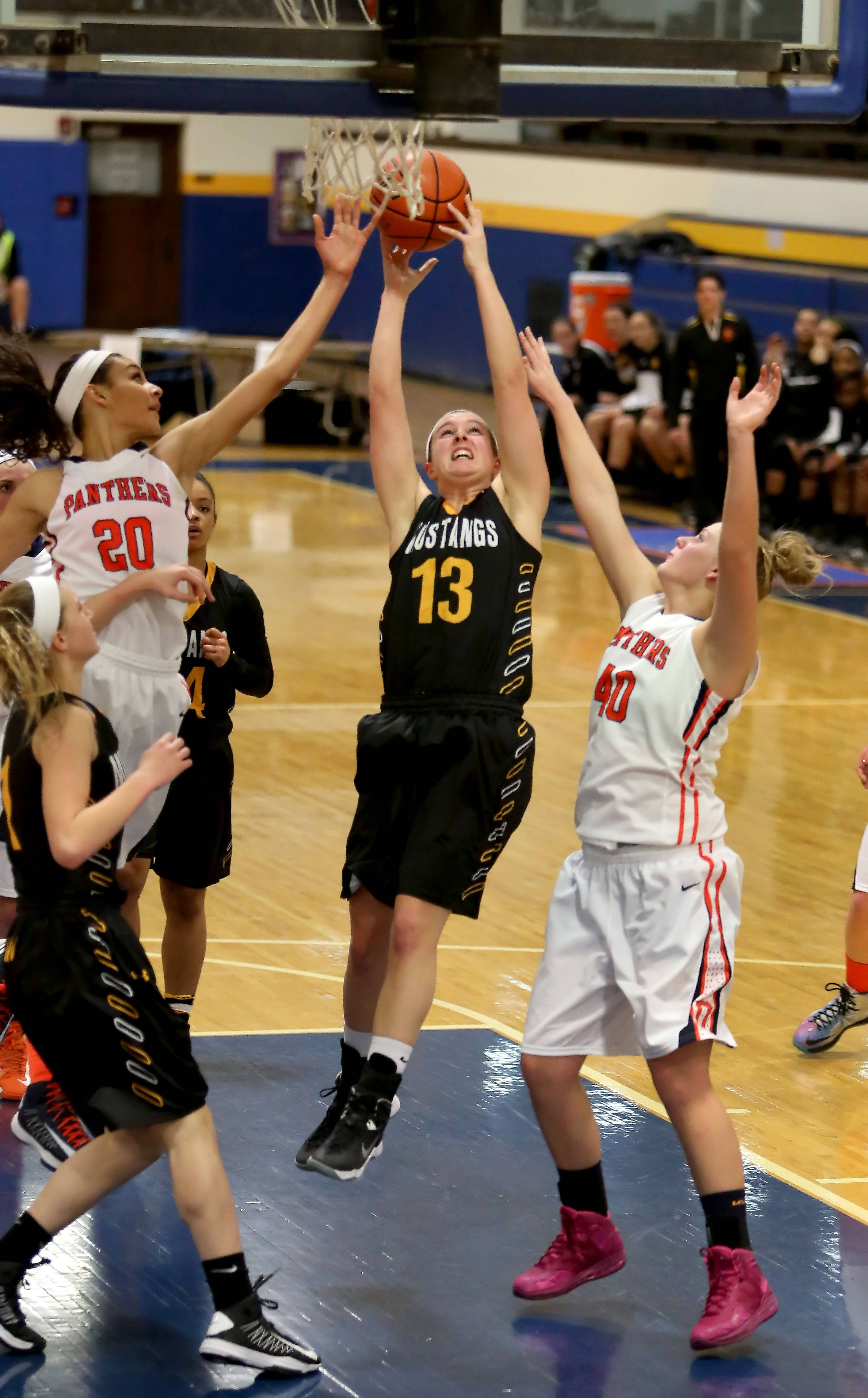 Metea Valley's Katie Lawrence goes for the rebound in action against Oswego in Class 4A sectional semifinal girls basketball on Monday in Joliet.