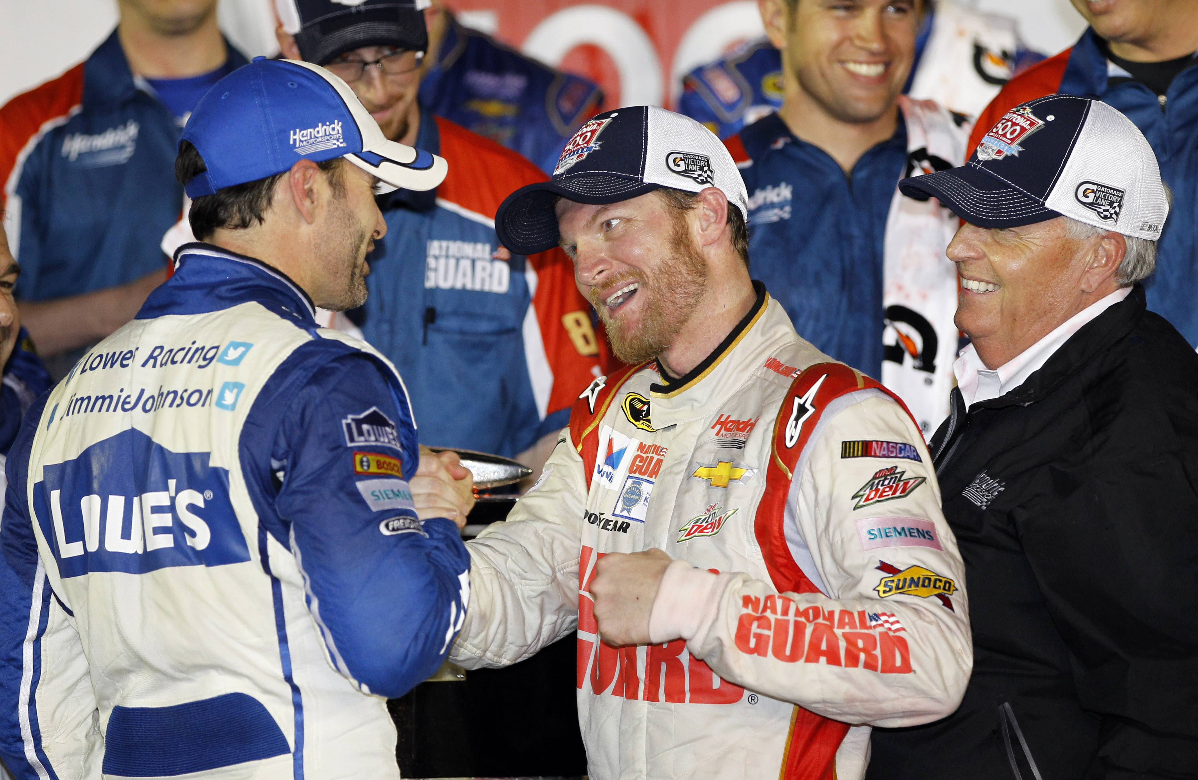 Dale Earnhardt Jr., center, celebrates in Victory Lane with teammate Jimmie Johnson, left, and team owner Rick Hendrick, right, after winning the NASCAR Daytona 500 Sprint Cup series auto race Sunday at Daytona International Speedway in Daytona Beach, Fla.