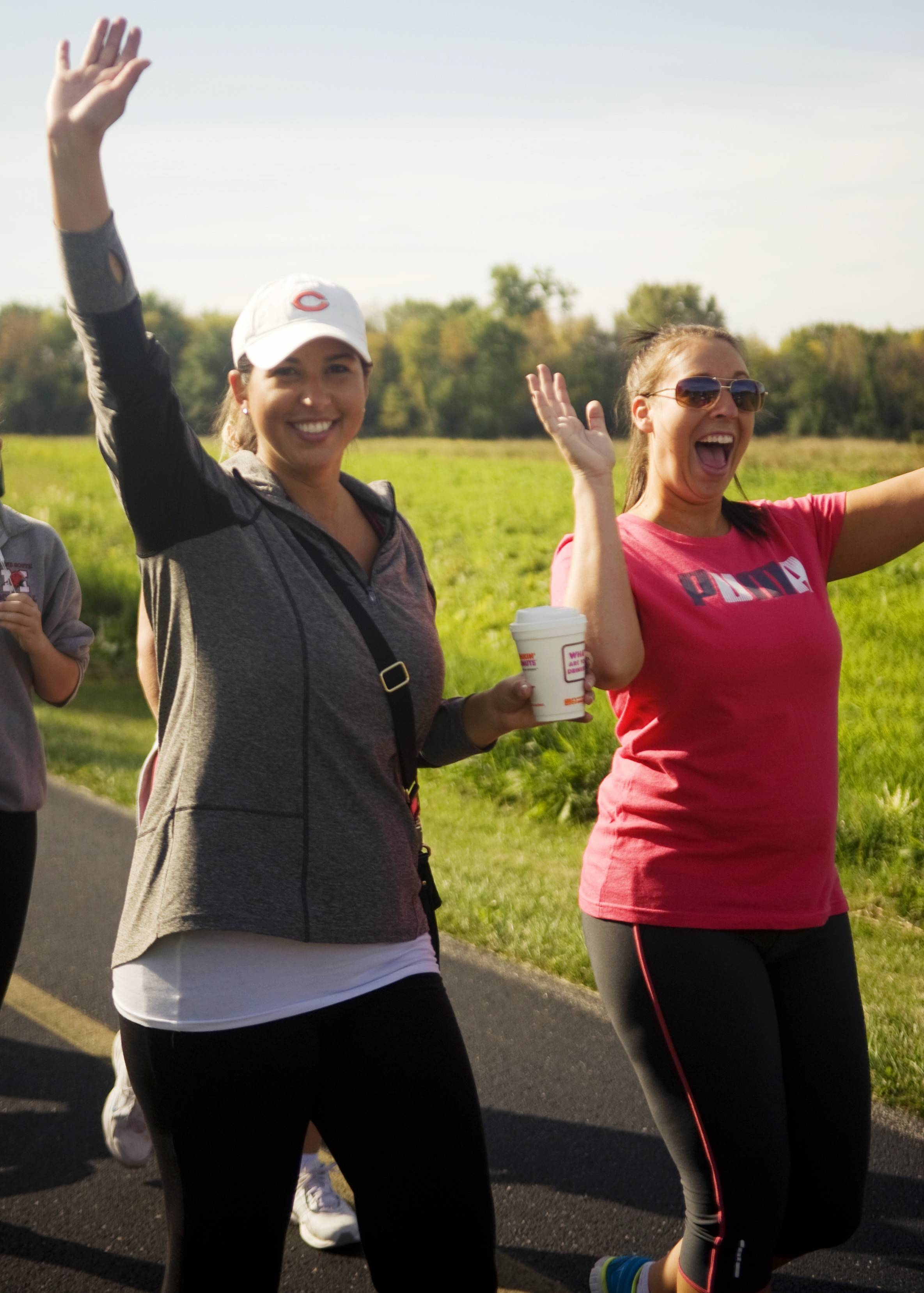 "Assurance colleagues Jennifer Jungers and Suzi Stephens get in the wellness spirit by doing a ""walking lunch"" at nearby Busse Woods in Schaumburg."