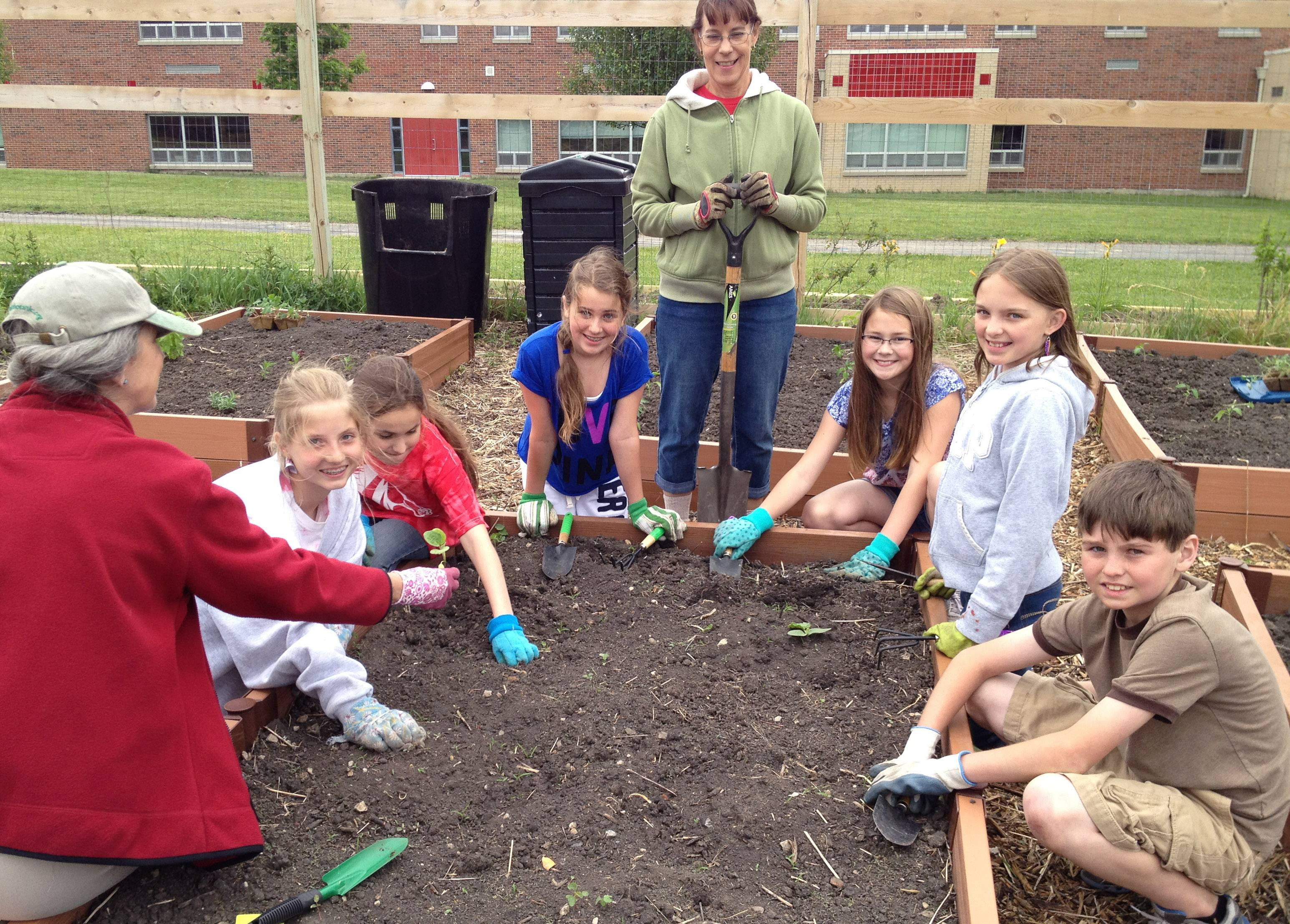 Millburn School students work in the community garden.