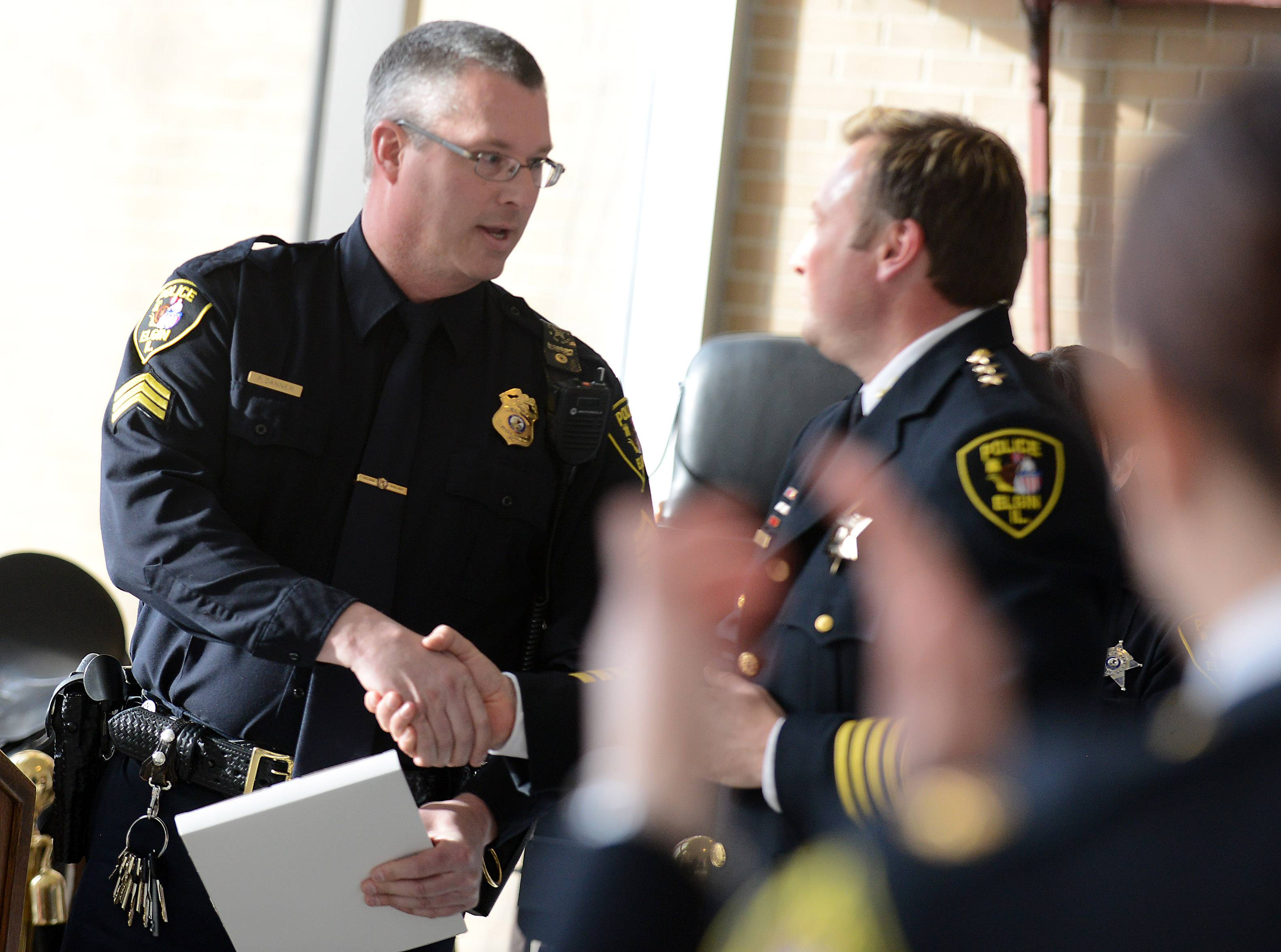 Sgt. Phil Danner, left, shakes hands with Elgin Police Chief Jeff Swoboda after being named Manager of the Year during the Elgin Police Department's annual awards ceremony Monday.