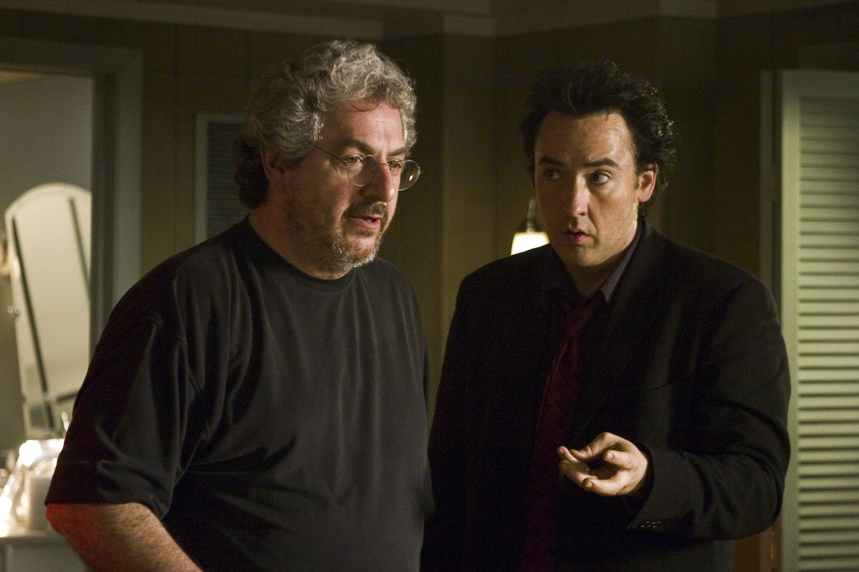 "Director Harold Ramis stretched his talents with the crime tale ""The Ice Harvest,"" a dramatic neo-noir starring Chicagoan John Cusack, right."
