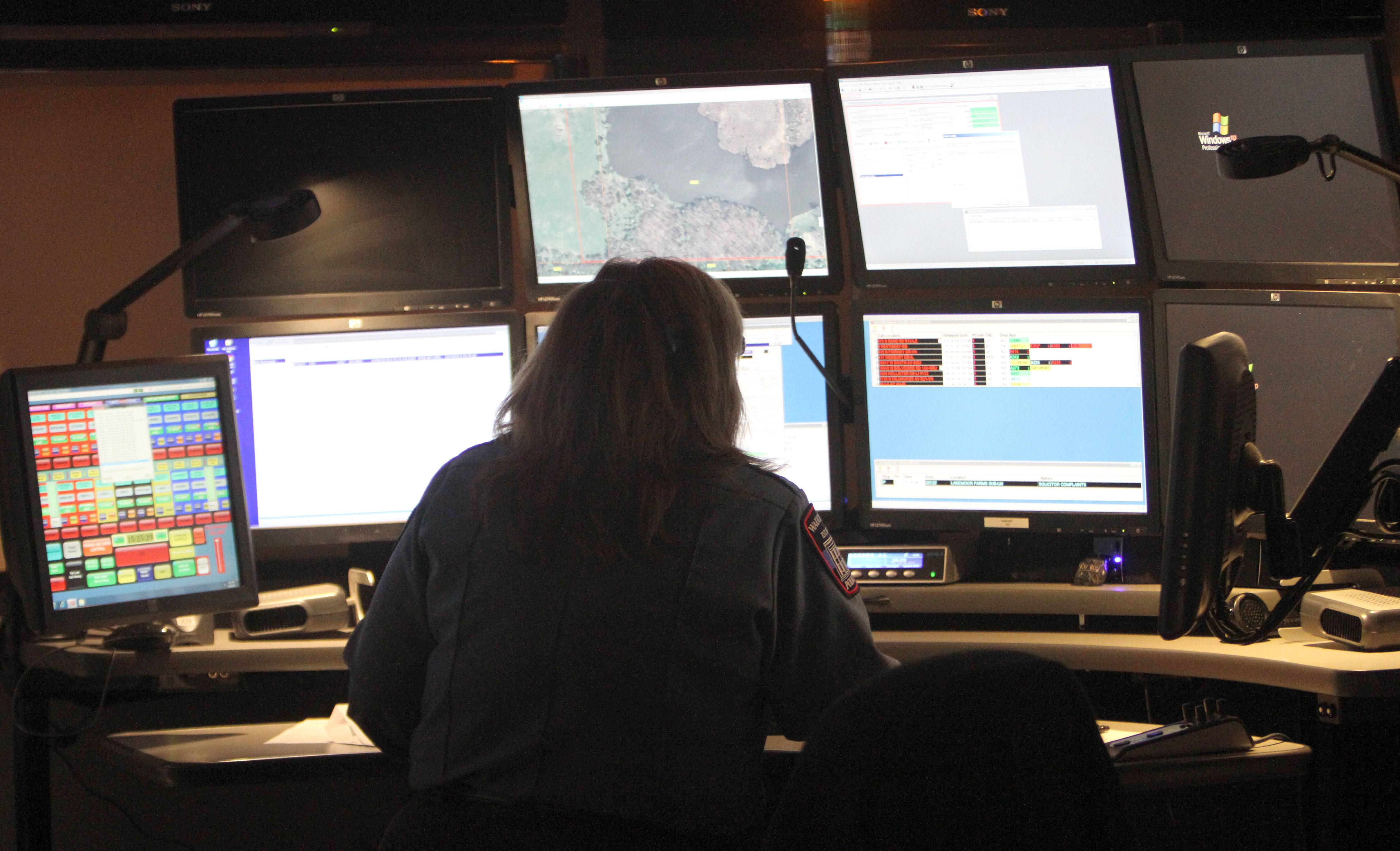 Dispatcher Joanne Schmoeller takes an emergency call at the Wauconda Police Department's 911 center. The service could be outsourced to Lake Zurich.