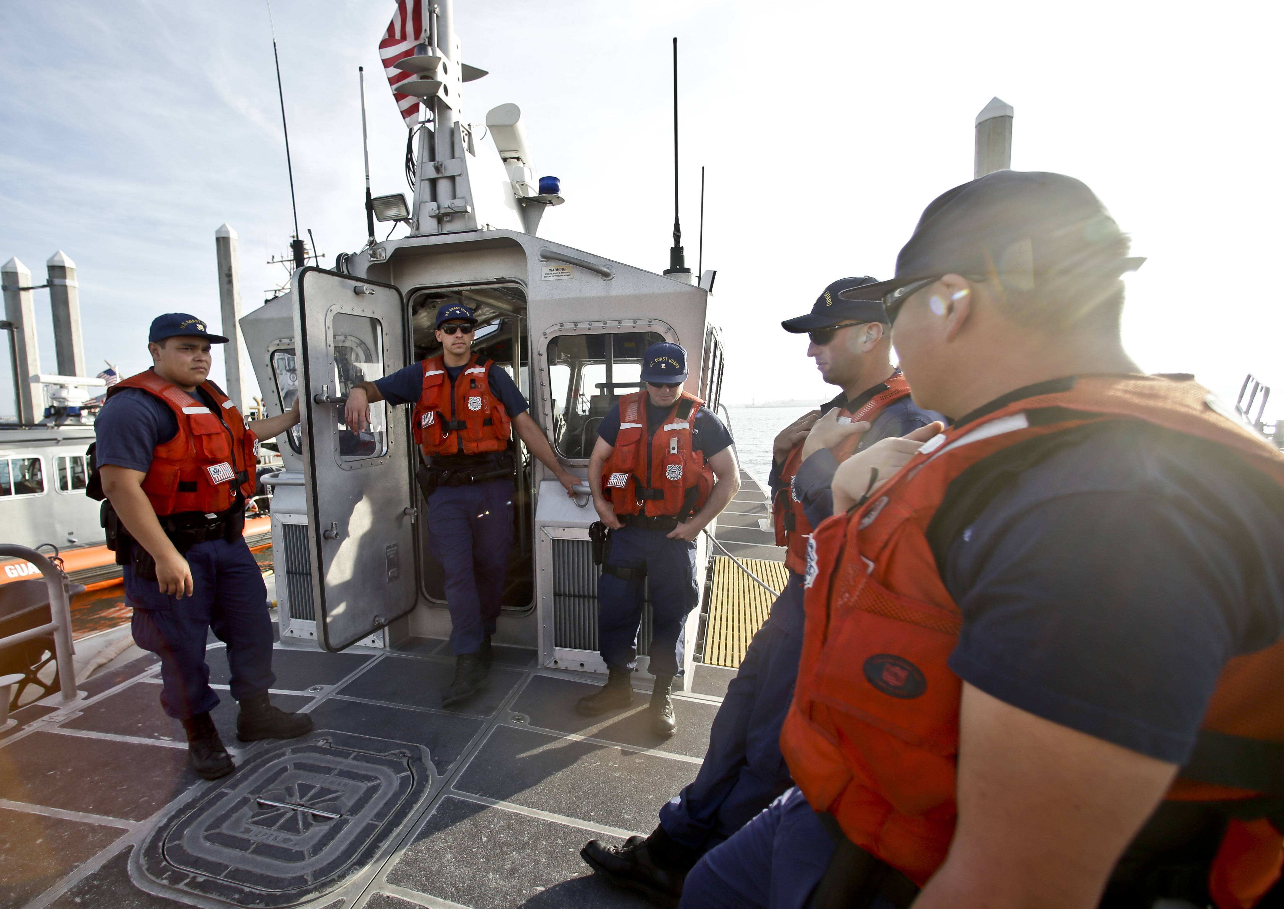 The crew of a 45 foot Coast Guard patrol boat runs through their pre-departure briefing in San Diego harbor in San Diego. With the drug war locking down land routes across Latin America and at the U.S. border, smugglers have been increasingly using large vessels to carry multi-ton loads of cocaine and marijuana hundreds of miles offshore where the lead federal agency with extensive law enforcement powers is the Coast Guard, a military service roughly the size of the New York Police Department.