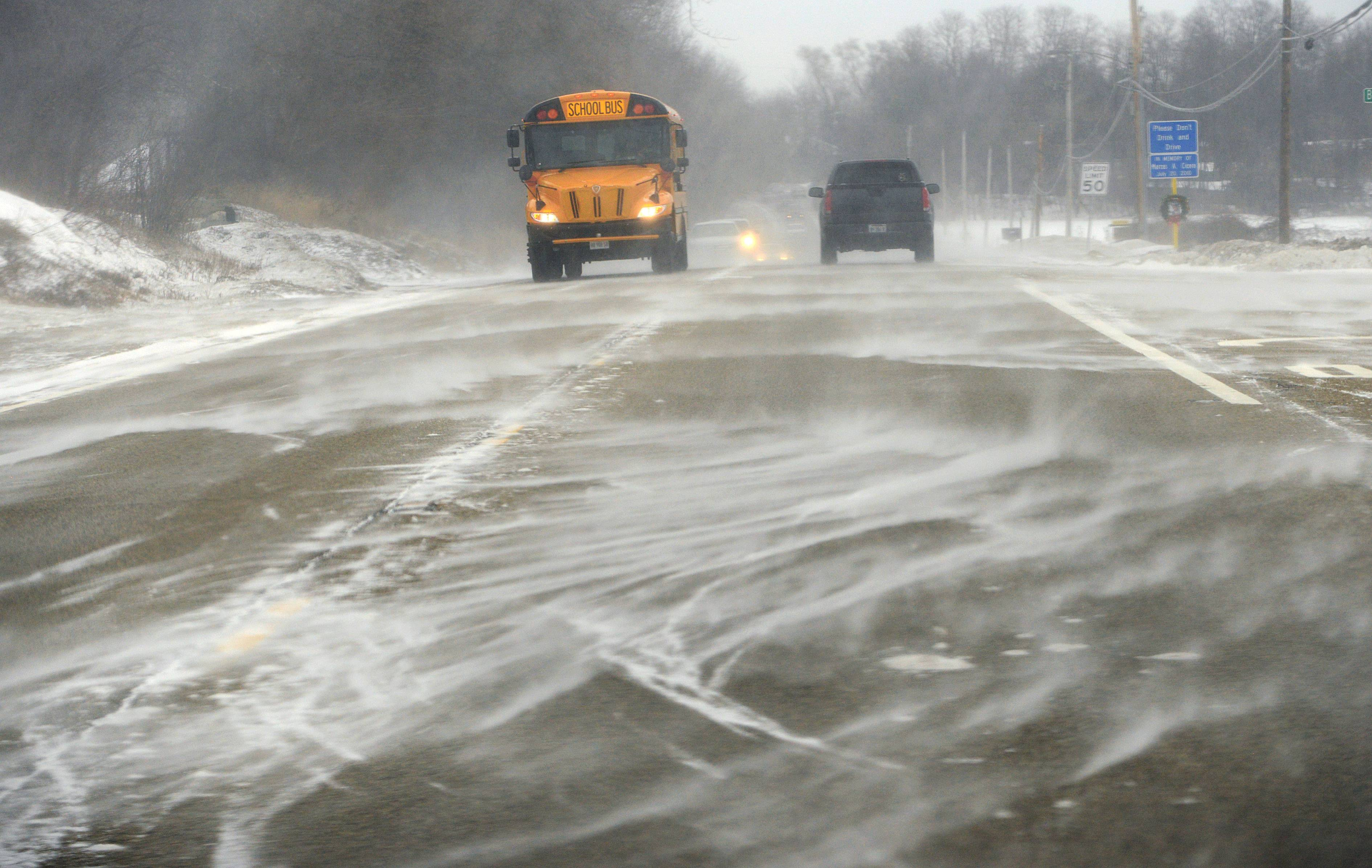 Snow drifts over Route 176 just west of Island Lake Friday morning.