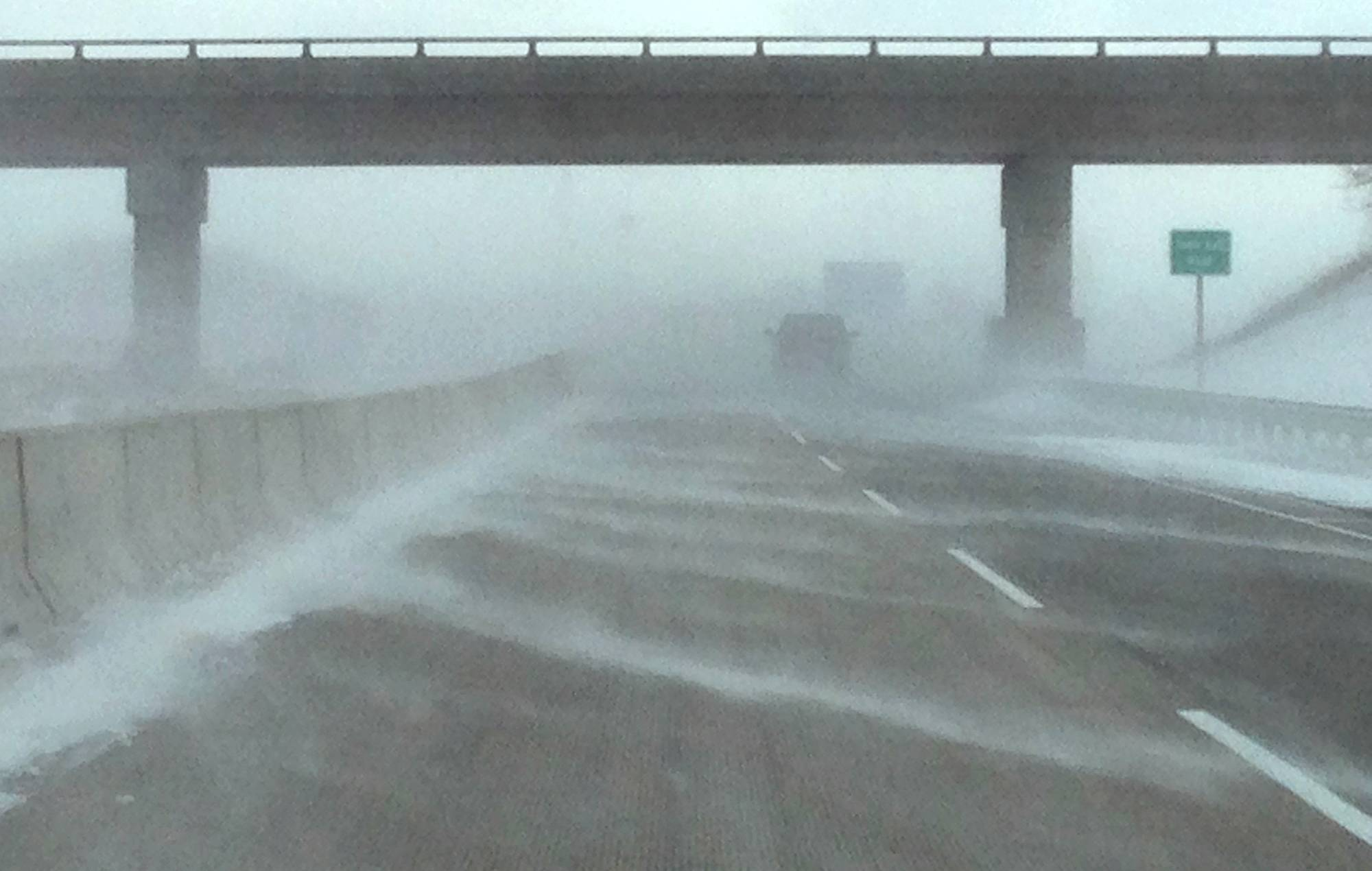 Christopher Hankins/chankins@daillyherald.comStrong winds created near white-out conditions on the eastbound Jane Addams Tollway west of Elgin Friday morning.