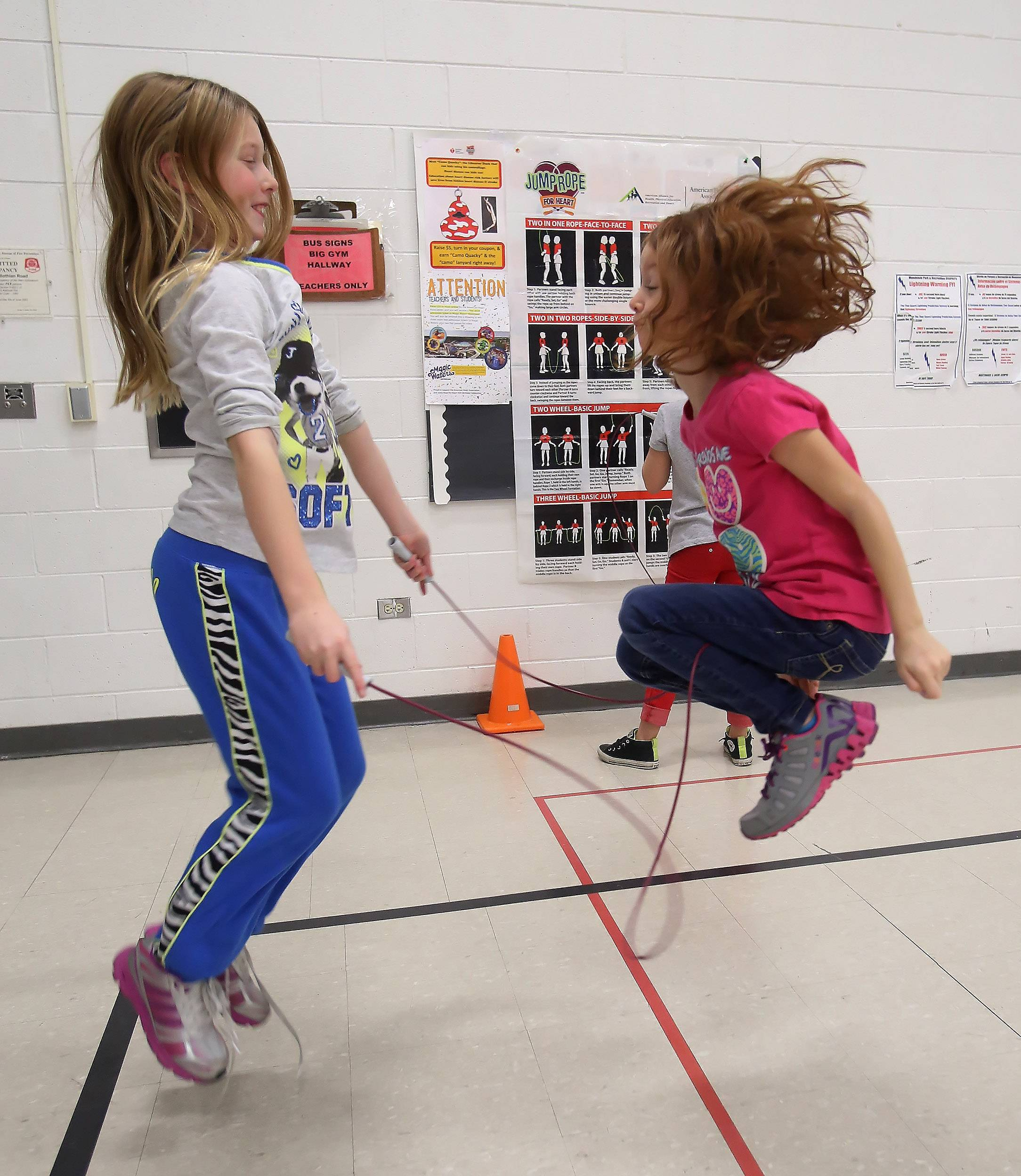 Third graders Katelyn Fletcher, left, and Mackenzie Czapla, jump rope together during Jump Rope for Heart Tuesday at Mechanics Grove School in Mundelein. Students in grades third through fifth raised money for the American Heart Association.