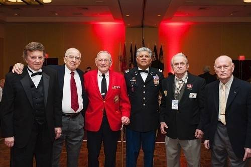 Chief Warrant Officer 4 Ty Simmons USA (Ret.) poses with World War II veterans at the 2014 Hearts of Valor Ball held Feb. 8, in Schaumburg.