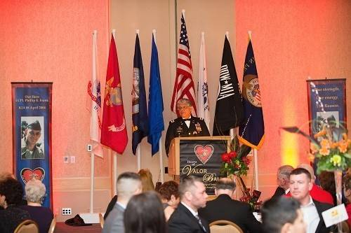 Chief Warrant Officer 4 Ty Simmons USA (Ret.) addresses the 2014 Hearts of Valor Ball guests. CW4 Simmons served in Vietnam and in Iraq. He was the first Vietnam veteran to be a keynote speaker at the Hearts of Valor Ball.
