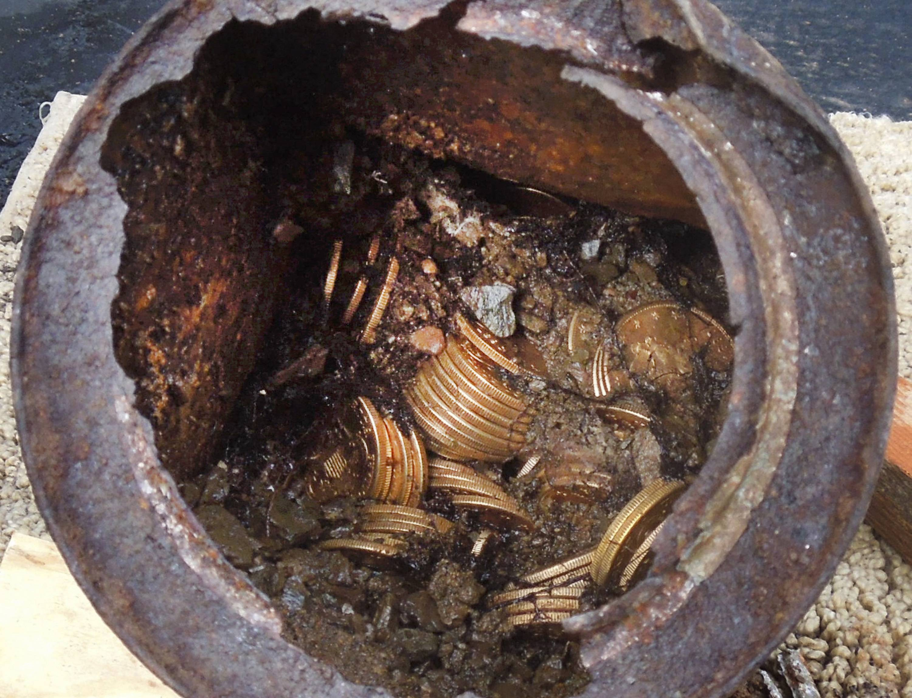 "This is one of the six decaying metal canisters filled with 1800s-era U.S. gold coins unearthed in California by two people who wish to remain anonymous. The value of the ""Saddle Ridge Hoard"" treasure trove is estimated at $10 million or more."