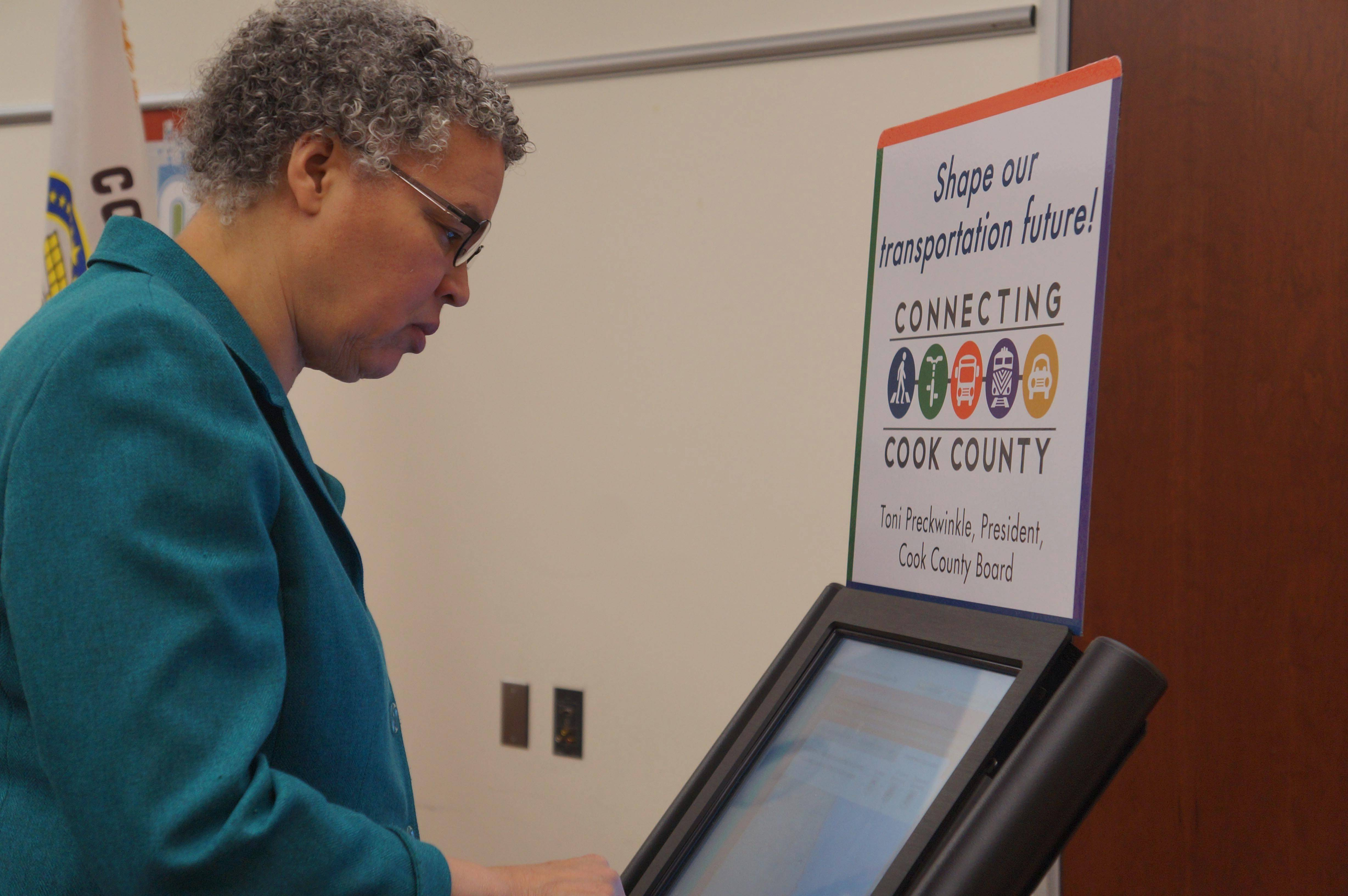 Photo courtesy of Cook County Cook County Board President Toni Preckwinkle shows a interactive kiosk that the public can use to give opinions about a 25-year transportation plan.