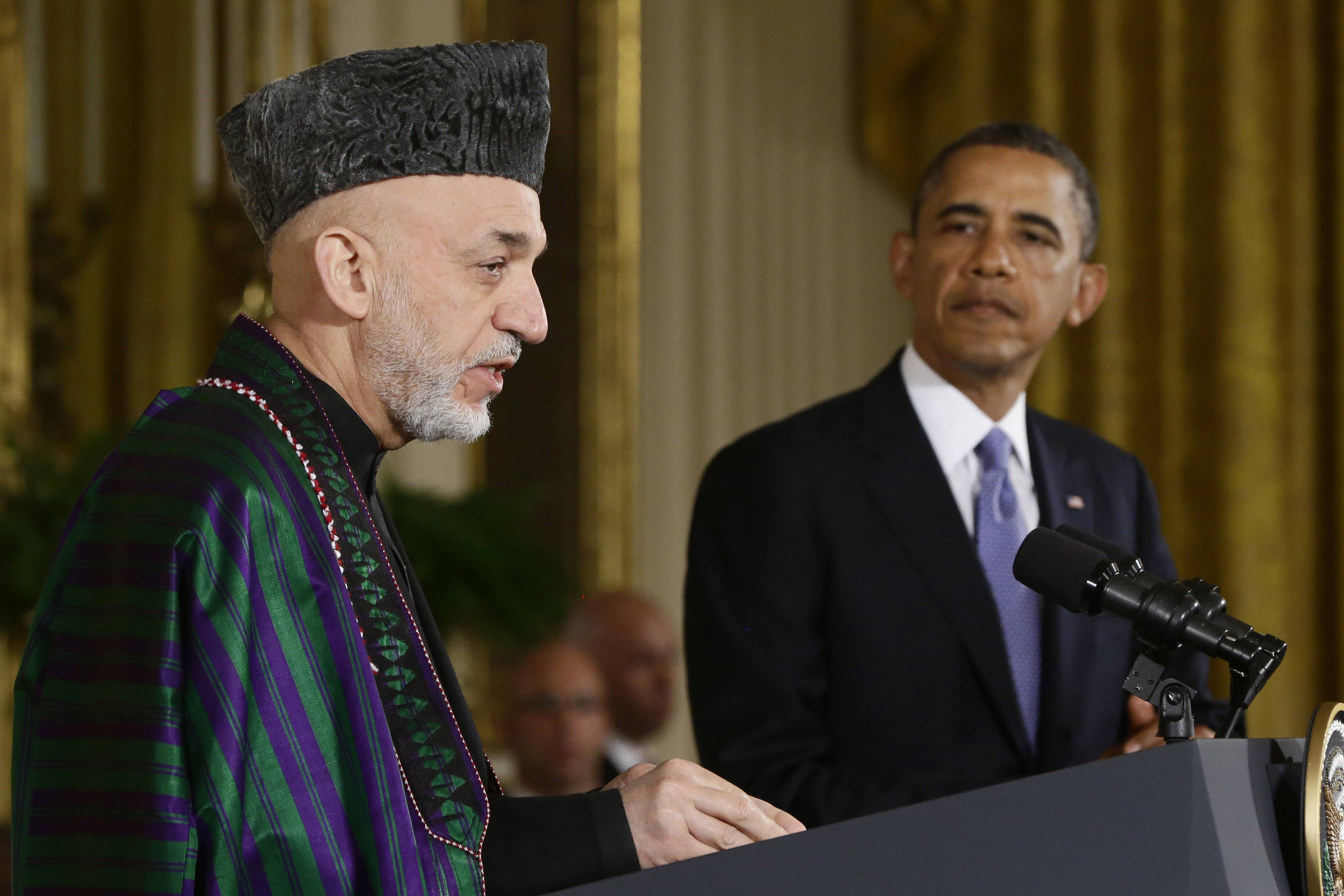 President Barack Obama and Afghan President Hamid Karzai conduct a joint news conference in the White House Jan. 11, 2013. Obama has ordered the Pentagon to plan for a full American withdrawal from Afghanistan by the end of this year should the Afghan government refuse to sign a security agreement with the U.S., the White House said Tuesday.