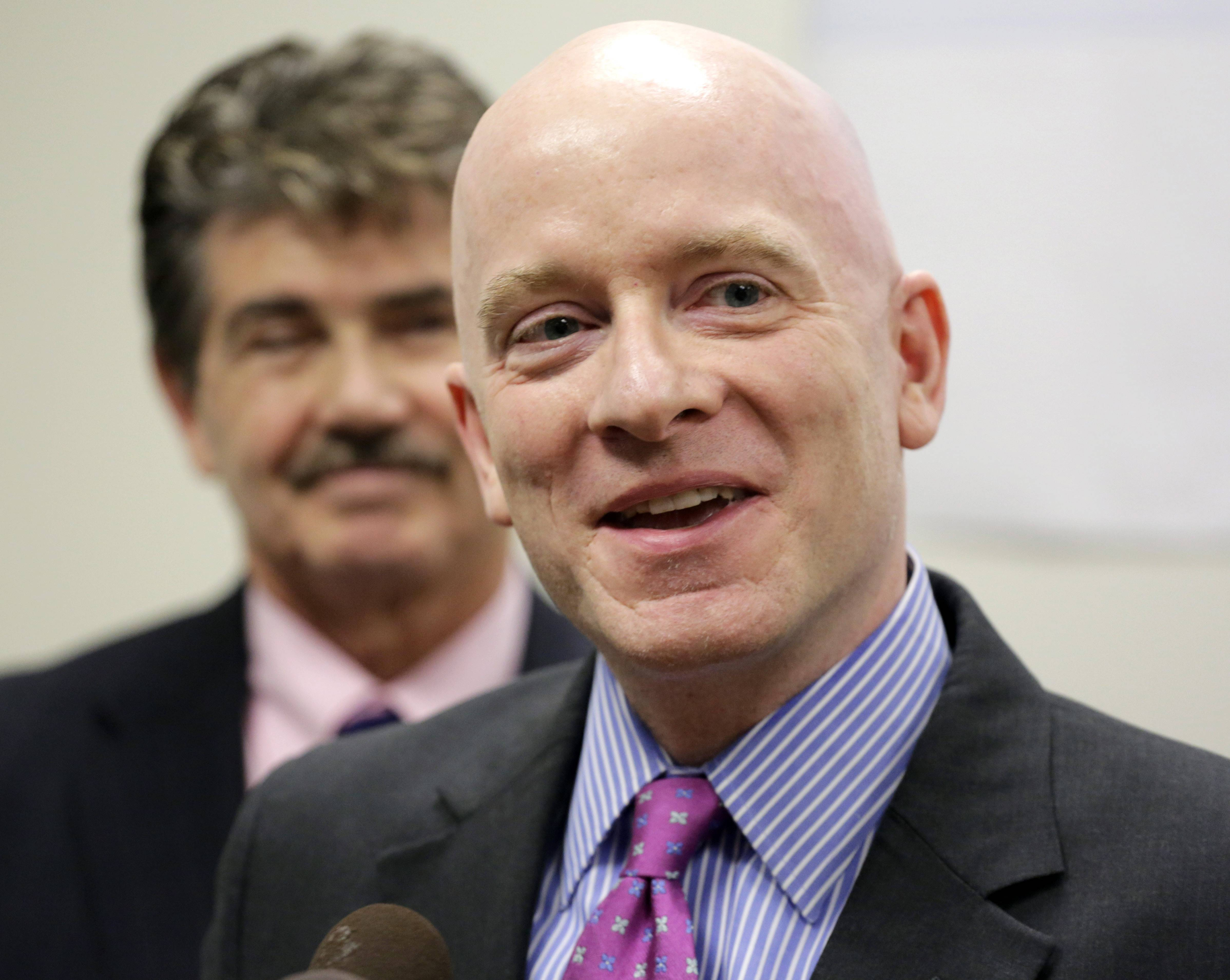 Cook County Clerk David Orr, left, and Christopher Clark, counsel at Lambda Legal speak at a news conference just after a federal judge ruled gay couples in the Chicago area don't have to wait until June to marry.