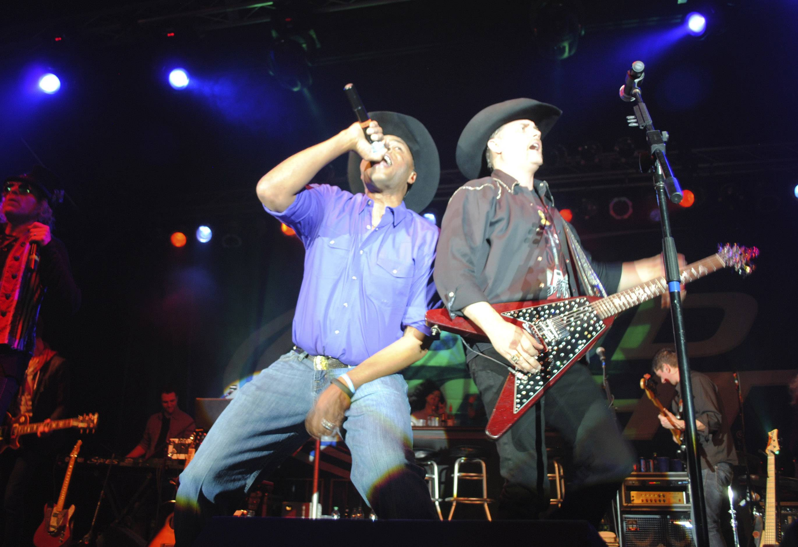 Cowboy Troy, left, joins John Rich, this past Saturday for the inaugural performance by Big & Rich at Austin's Fuel Arena at the Lake County Fairgrounds in Grayslake.