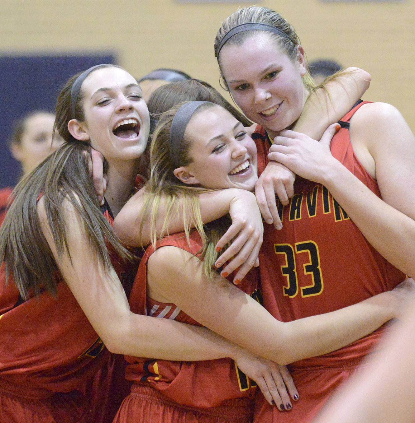 Batavia's Mackenzie Foster, left, Katie Weber, center, and Erin Bayram, right, embrace as they walk off the court after their 4A sectional semifinal win over Downers Grove North at Addison Trail High School in Addison on Tuesday, February 25.