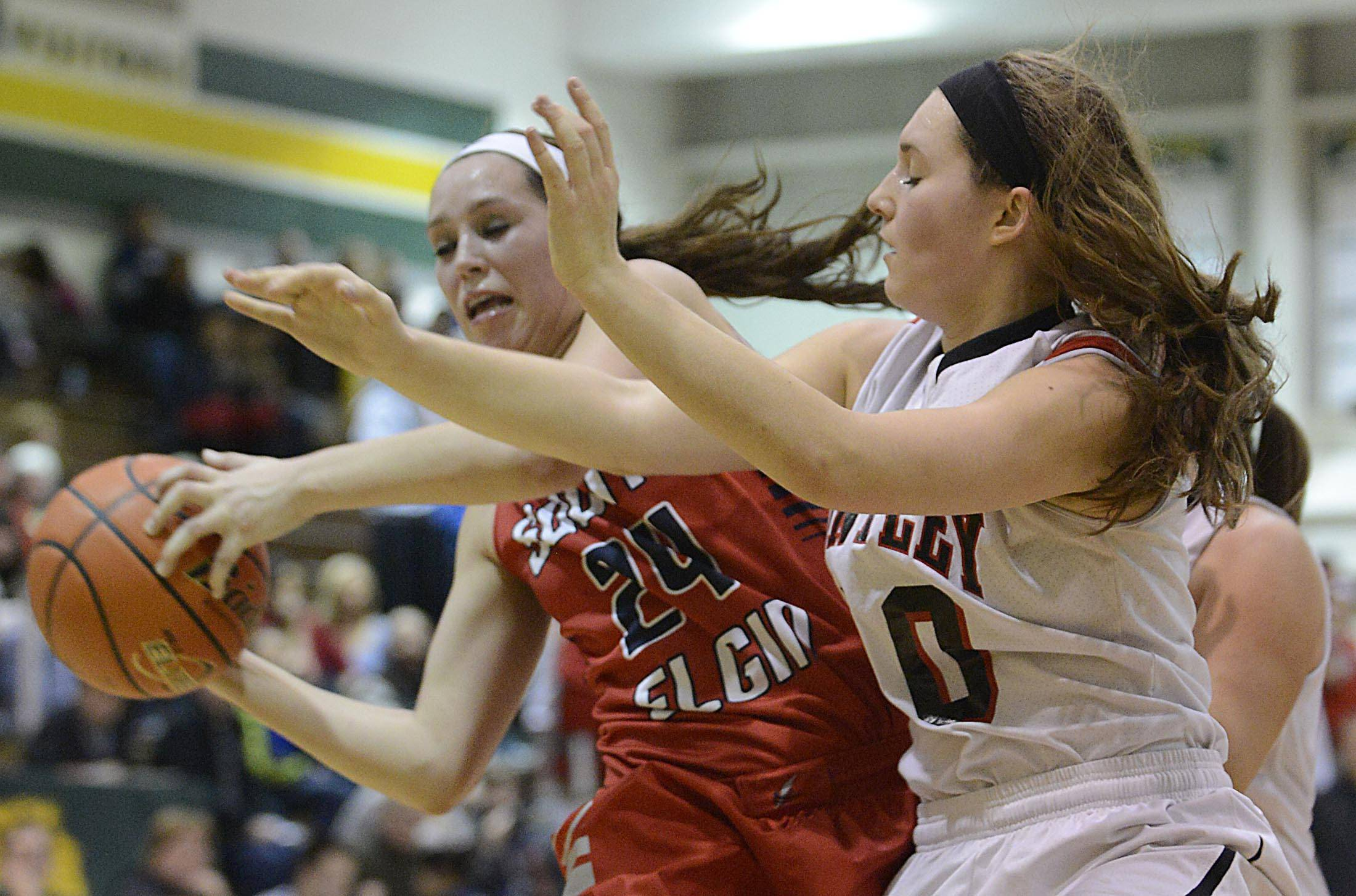 Huntley's Sam Andrews, right, battles with South Elgin's Kennede Miller for control of the ball Tuesday night during the Class 4A Crystal Lake South sectional semifinals.