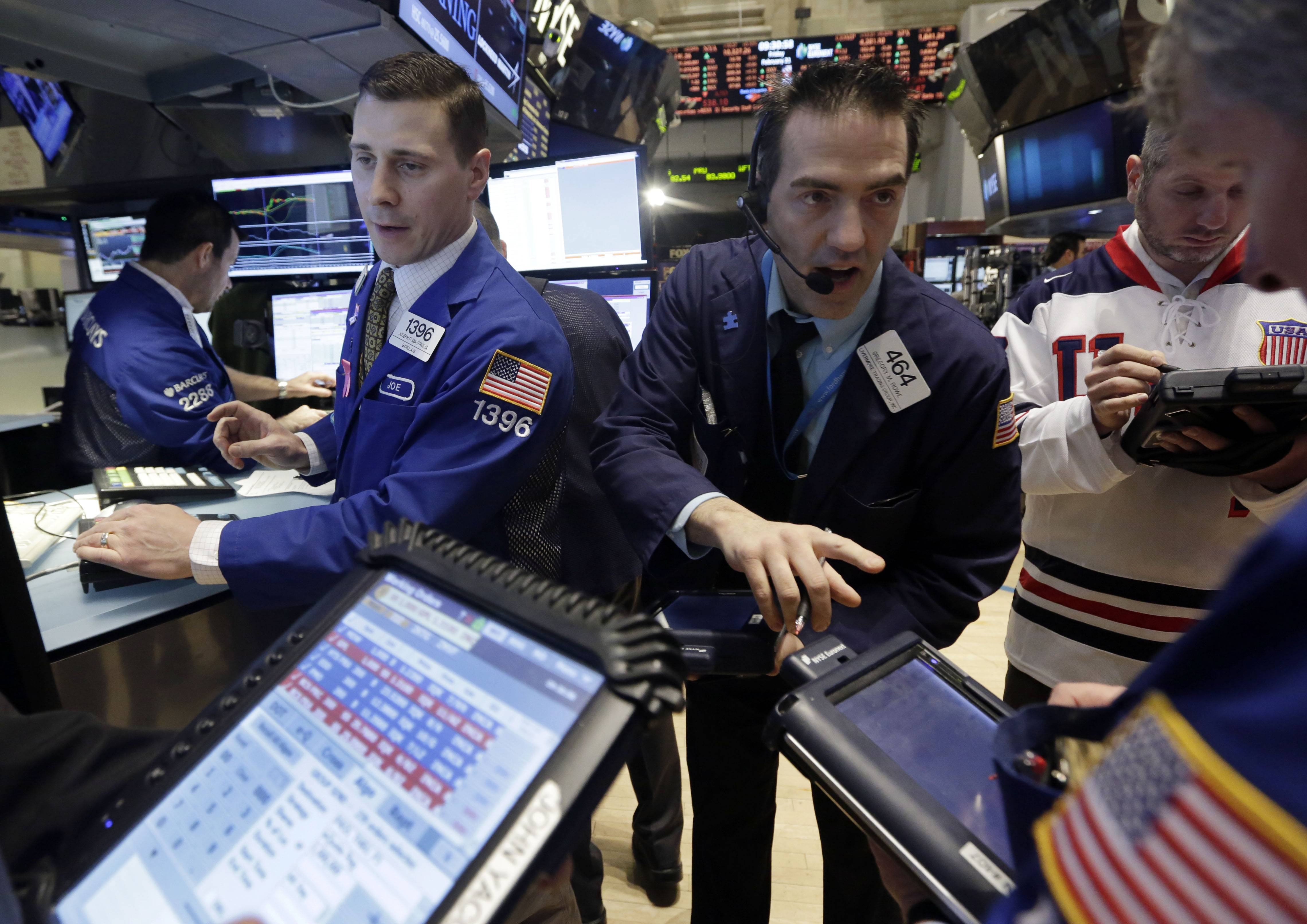 Stocks fell Tuesday, with the Standard & Poor's 500 failing to break a record for a second day, after data showed slower growth in home prices and a drop in consumer confidence.