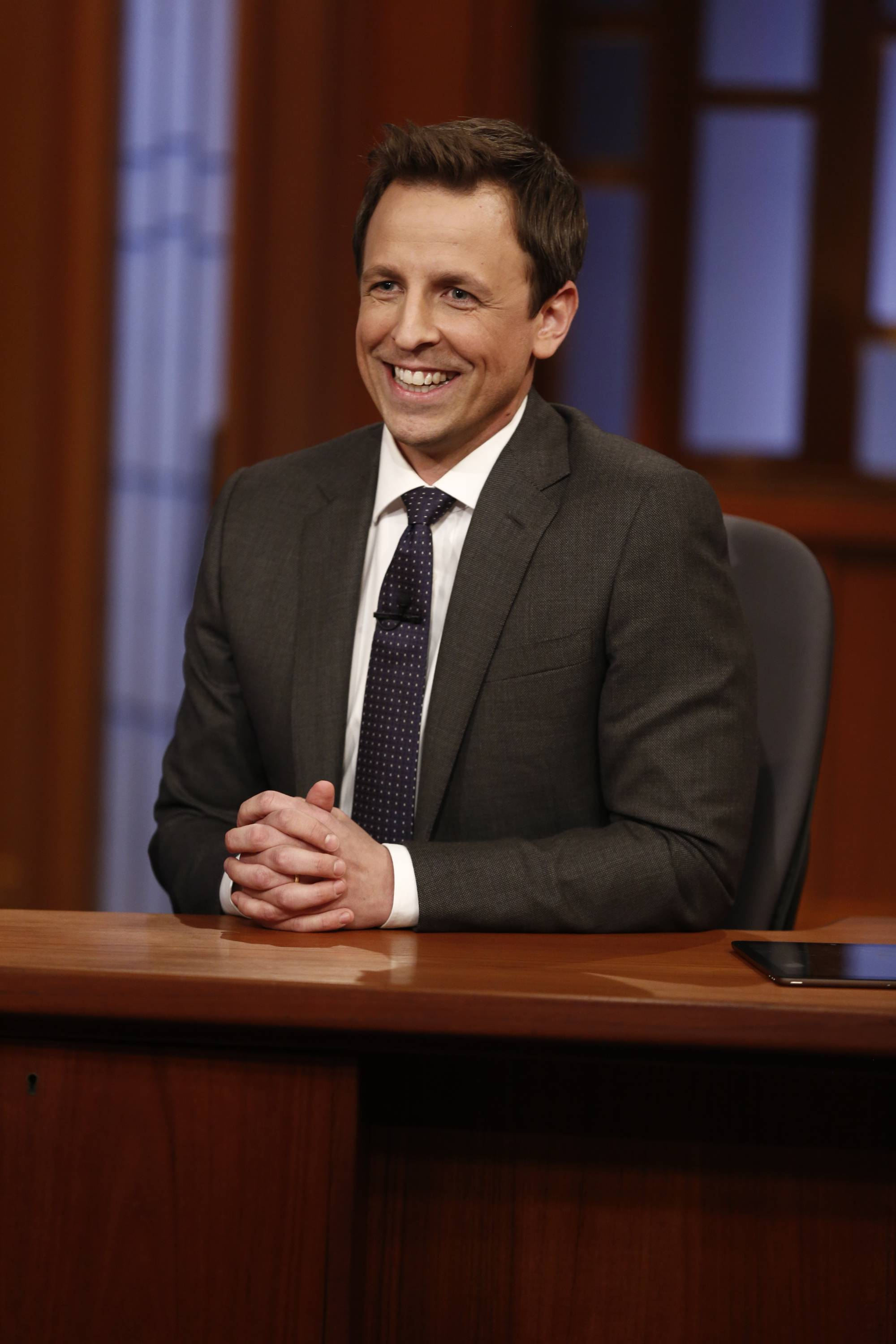 "Host Seth Meyers smiles during the premiere of ""Late Night With Seth Meyers"" on Monday in New York."