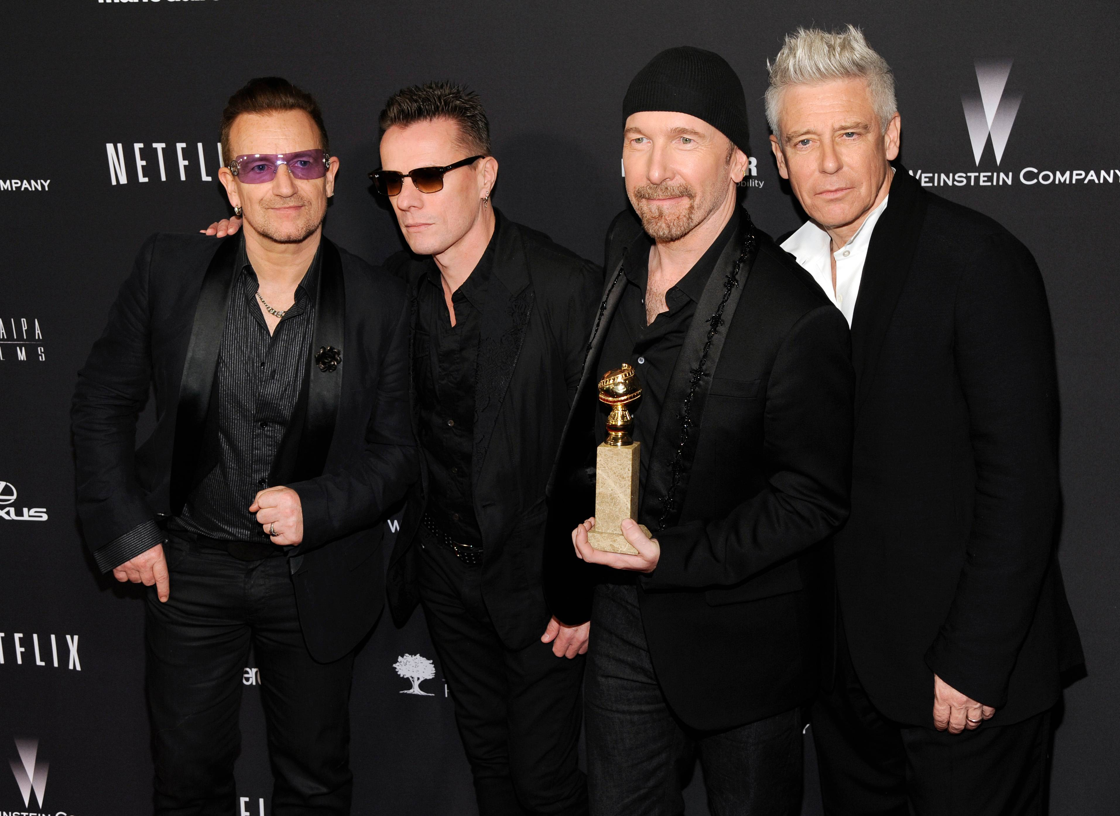 "U2 -- Bono, left, Larry Mullen Jr., The Edge and Adam Clayton -- is slated to perform the band's nominated song, ""Ordinary Love"" from the film ""Mandela: Long Walk to Freedom,"" at the 86th Academy Awards on Sunday, March 2."