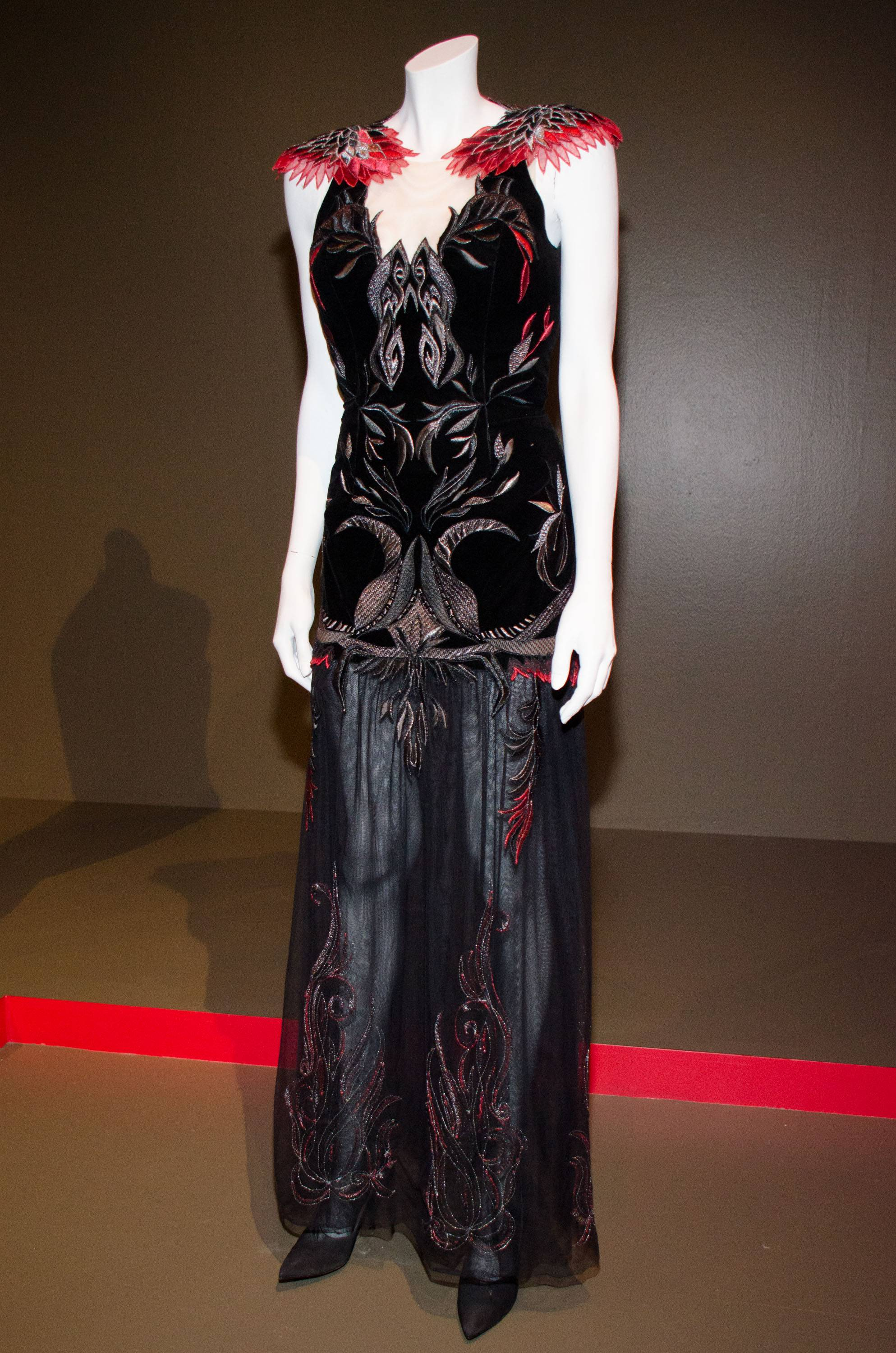 "A costume for ""The Hunger Games: Catching Fire"" by costume designer Trish Summerville is on display at the FIDM Museum's 22nd Annual Art of Motion Picture Costume Design Exhibit in Los Angeles."