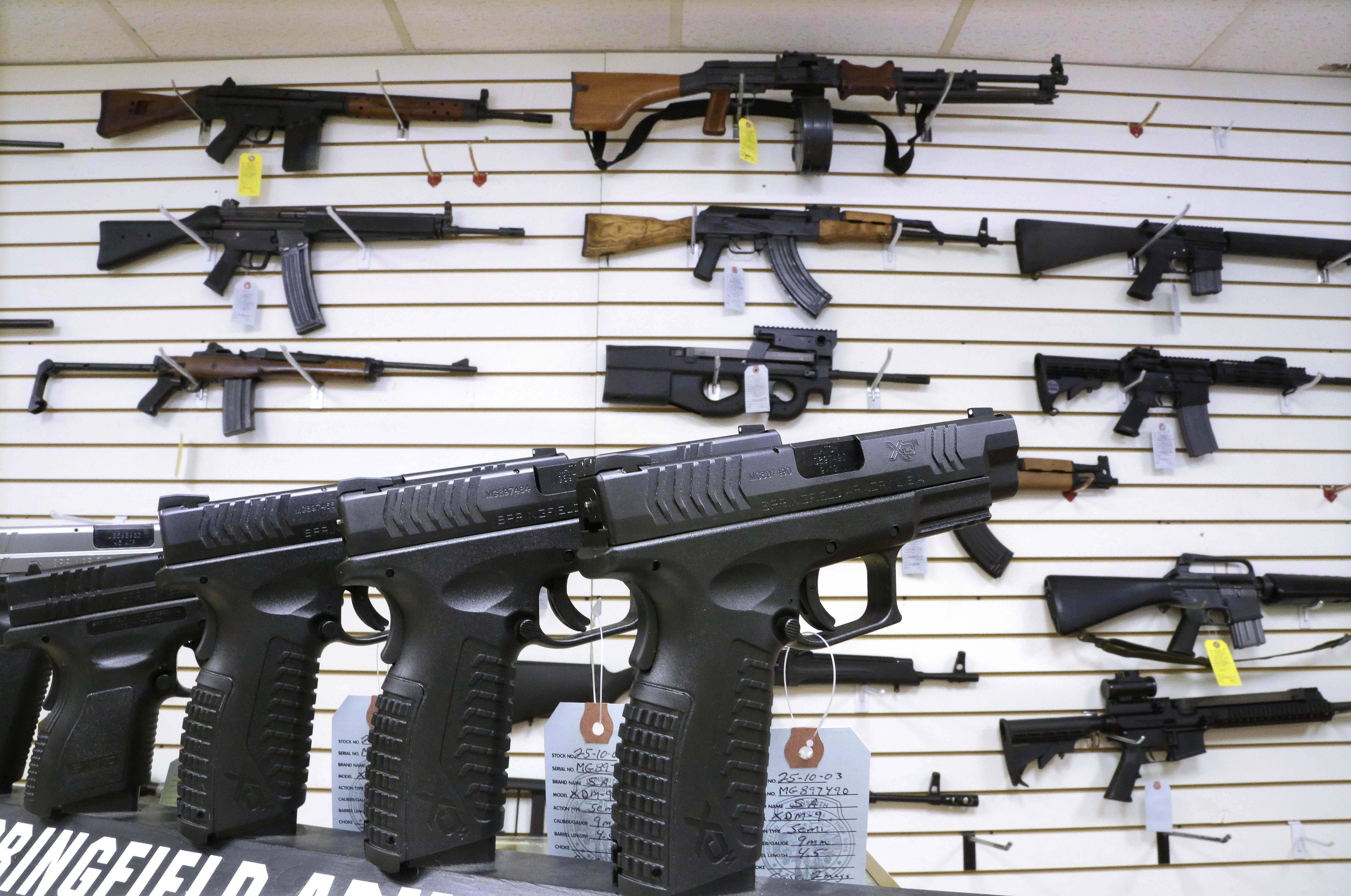 In this Jan. 16 photo, assault weapons and handguns are seen for sale at Capitol City Arms Supply in Springfield. In a questionnaire for The Associated Press, the four GOP candidates for governor, state Sens. Bill Brady and Kirk Dillard, state Treasurer Dan Rutherford and businessman Bruce Rauner disagree on whether assault-style weapons should be banned. They also disagree on whether to support a measure creating minimum prison sentences for gun crimes.