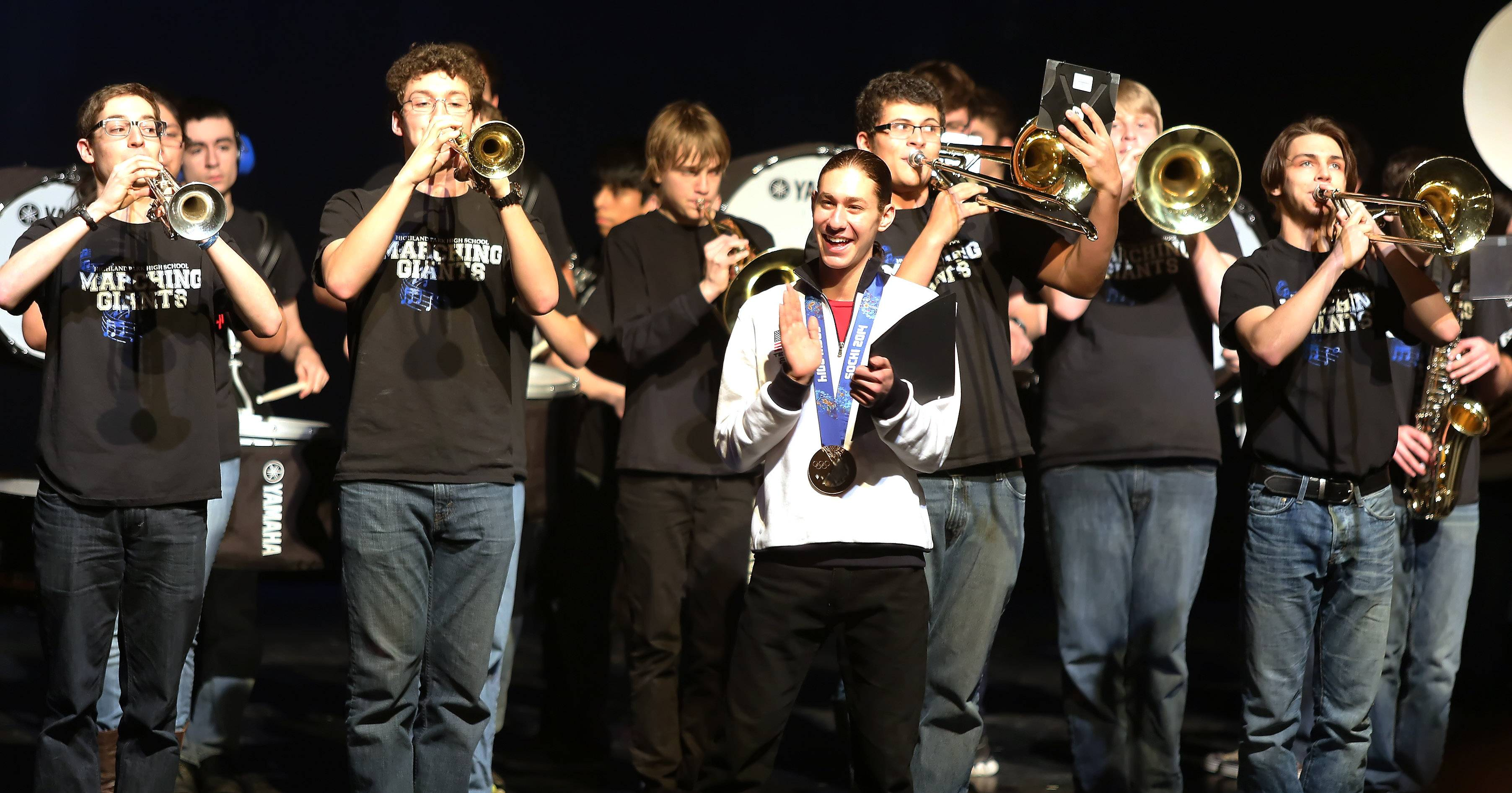 Highland Park High School's marching band plays behind Olympic figure skater Jason Brown, who was welcomed home in a ceremony Tuesday. Brown won a bronze medal in team figure skating at the 2014 Sochi Winter Olympics.