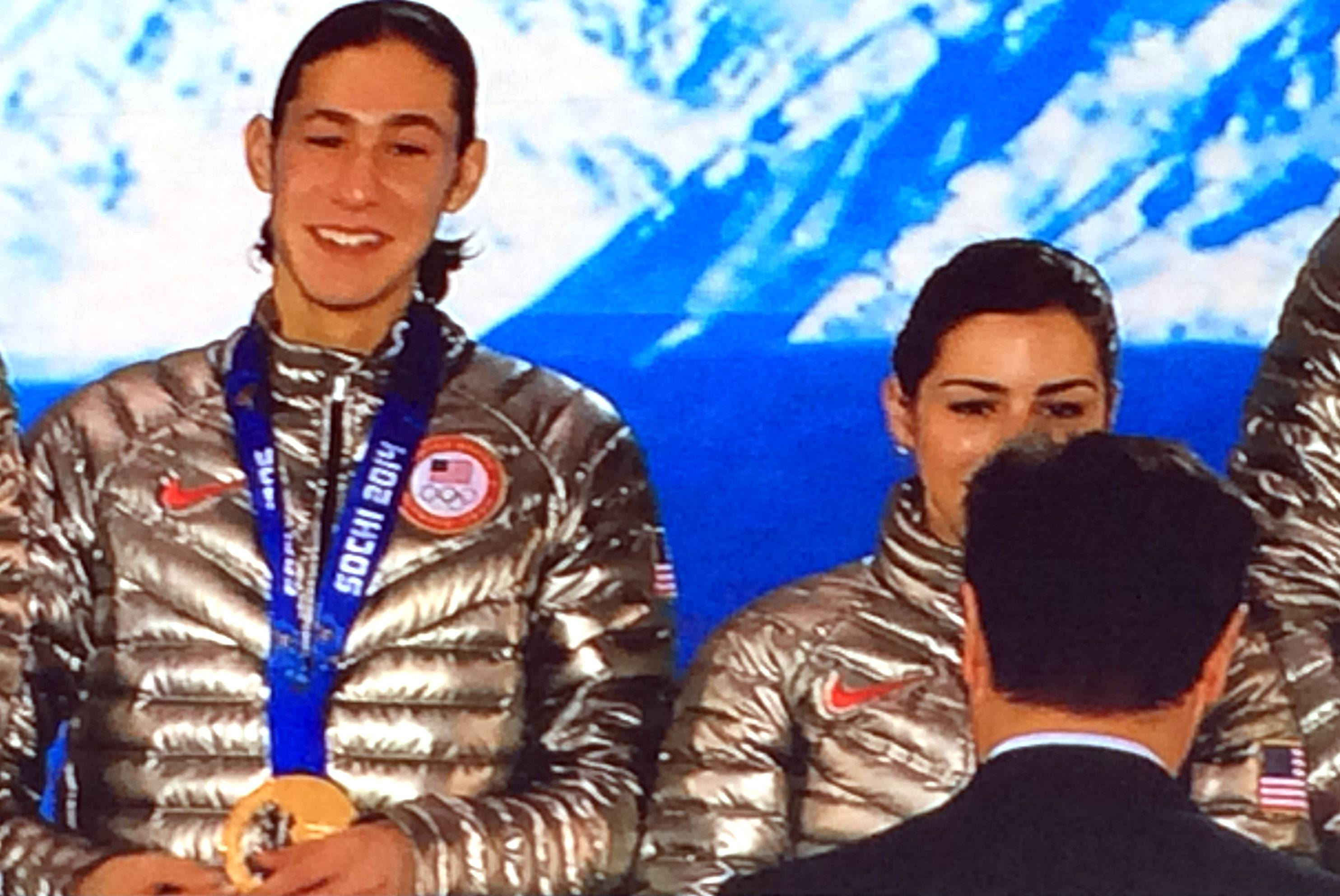 Photo of a video monitor shows Highland Park figure skater Jason Brown receiving his bronze medal this month at the Sochi Winter Olympics.