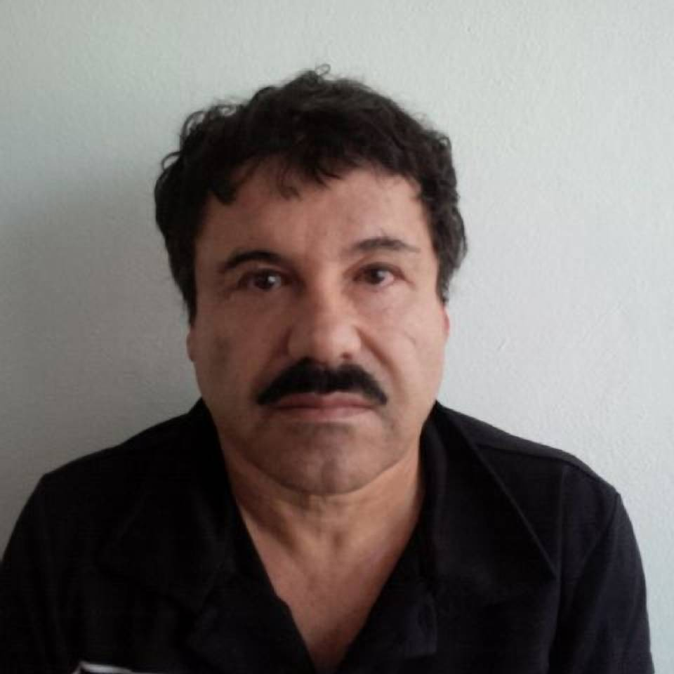 "Joaquin ""El Chapo"" Guzman against a wall after his arrest in the Pacific resort city of Mazatlan, Mexico. Federal prosecutors in Chicago and across the U.S. are already jockeying over who will handle any case against drug kingpin Guzman, even though it's far from clear whether he'll ever be brought to the United States to face charges."