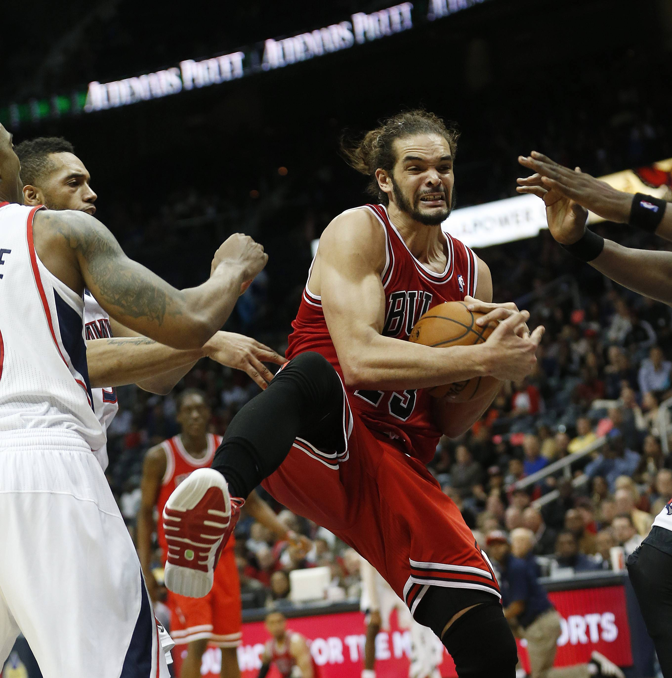 Bulls center Joakim Noah pulls down a rebound in the second half Tuesday night. Noah finished with 20 points and 12 rebounds in the Bulls' victory.