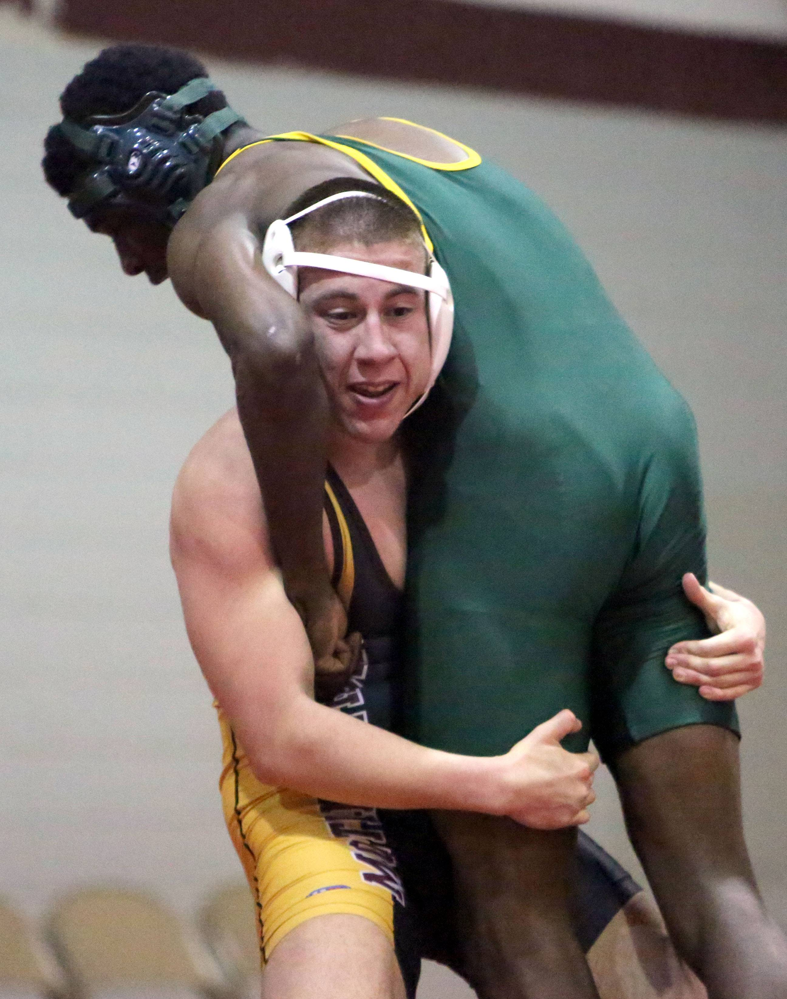 Steve Lundy/slundy@dailyherald.comMontini's Mitch Navaro, left, lifts Westinghouse's Darius Humphrey at 170 pounds during team sectional wrestling at Antioch High School Tuesday night.