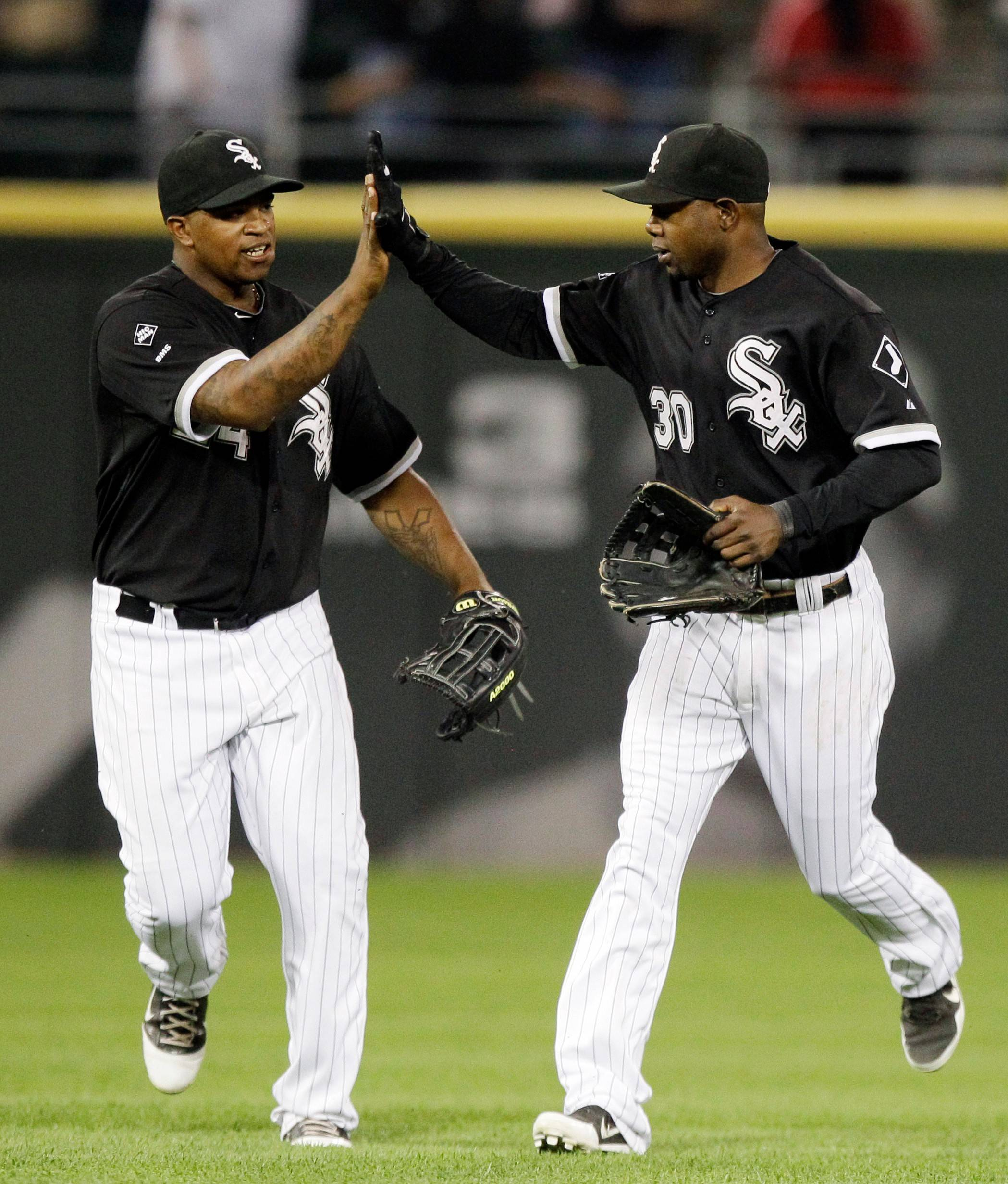 Alejandro De Aza, right, and Dayan Viciedo may platoon in left field for the White Sox this season.