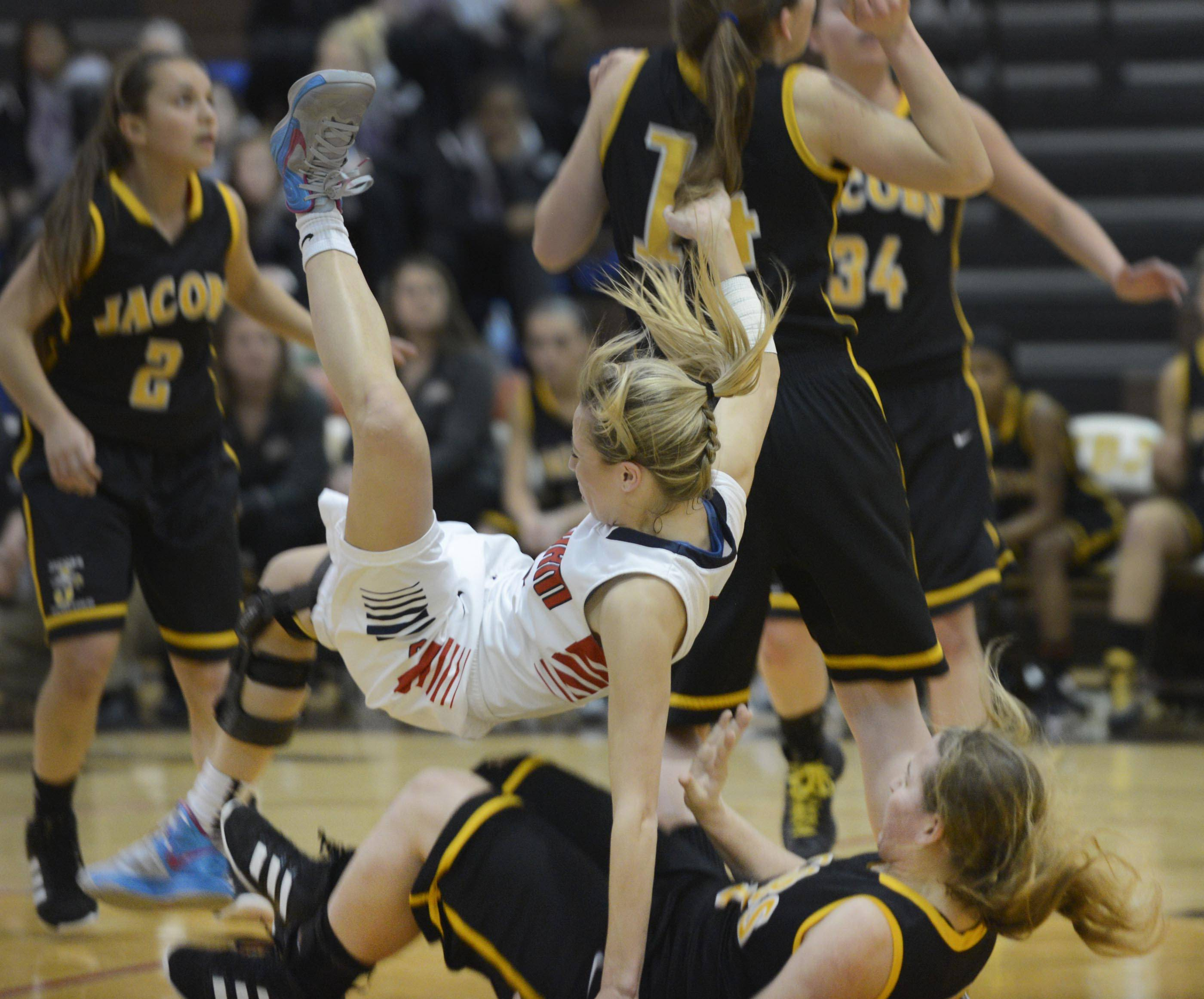 South Elgin's Savanah Uveges falls on Jacobs' Alyssa Lach during Tuesday's regional semifinal game in Algonquin.