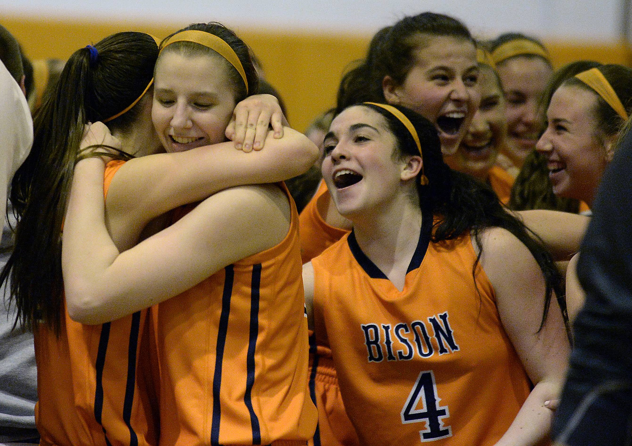 Buffalo Grove's Maddy Callahan, Maddie Welter and Julie Jambrone (4) celebrate their overtime victory Thursday against Prospect in the Class 4A regional championship game in Buffalo Grove.