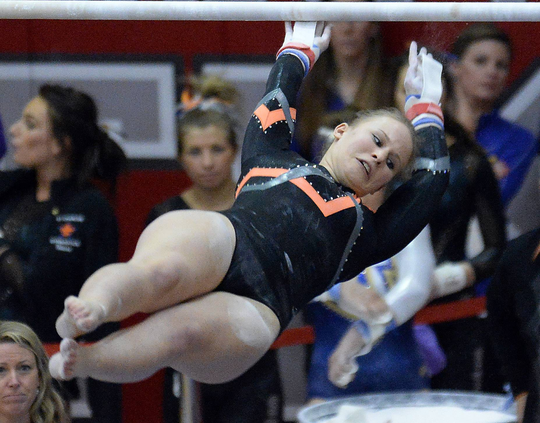 Libertyville's Mariah Lee competes on the uneven parallel bars in Friday's girls state gymnastics meet in Palatine.