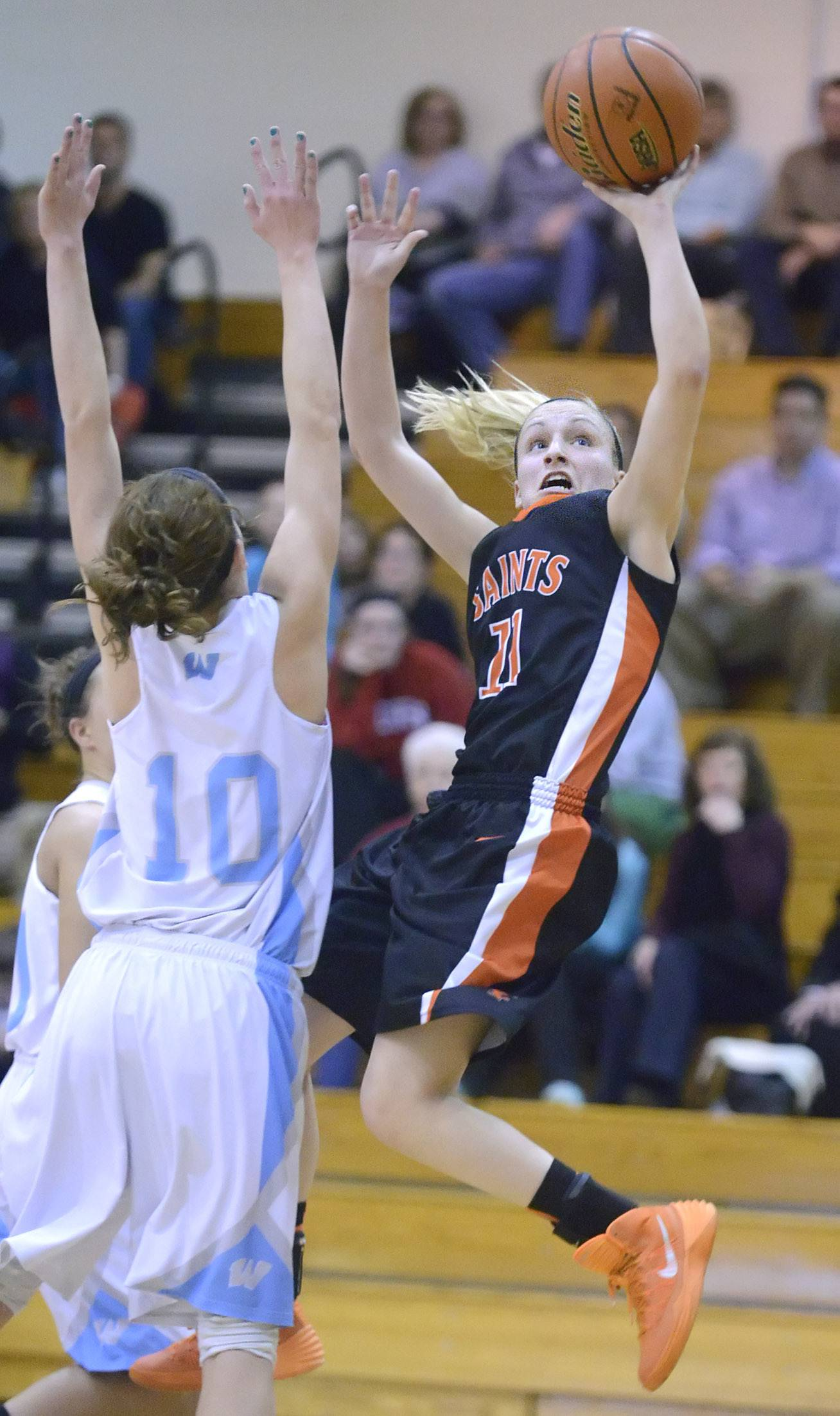 St. Charles East's Katelyn Claussner shoots over a block by Willowbrook's Molly Krawczykowski on Tuesday.