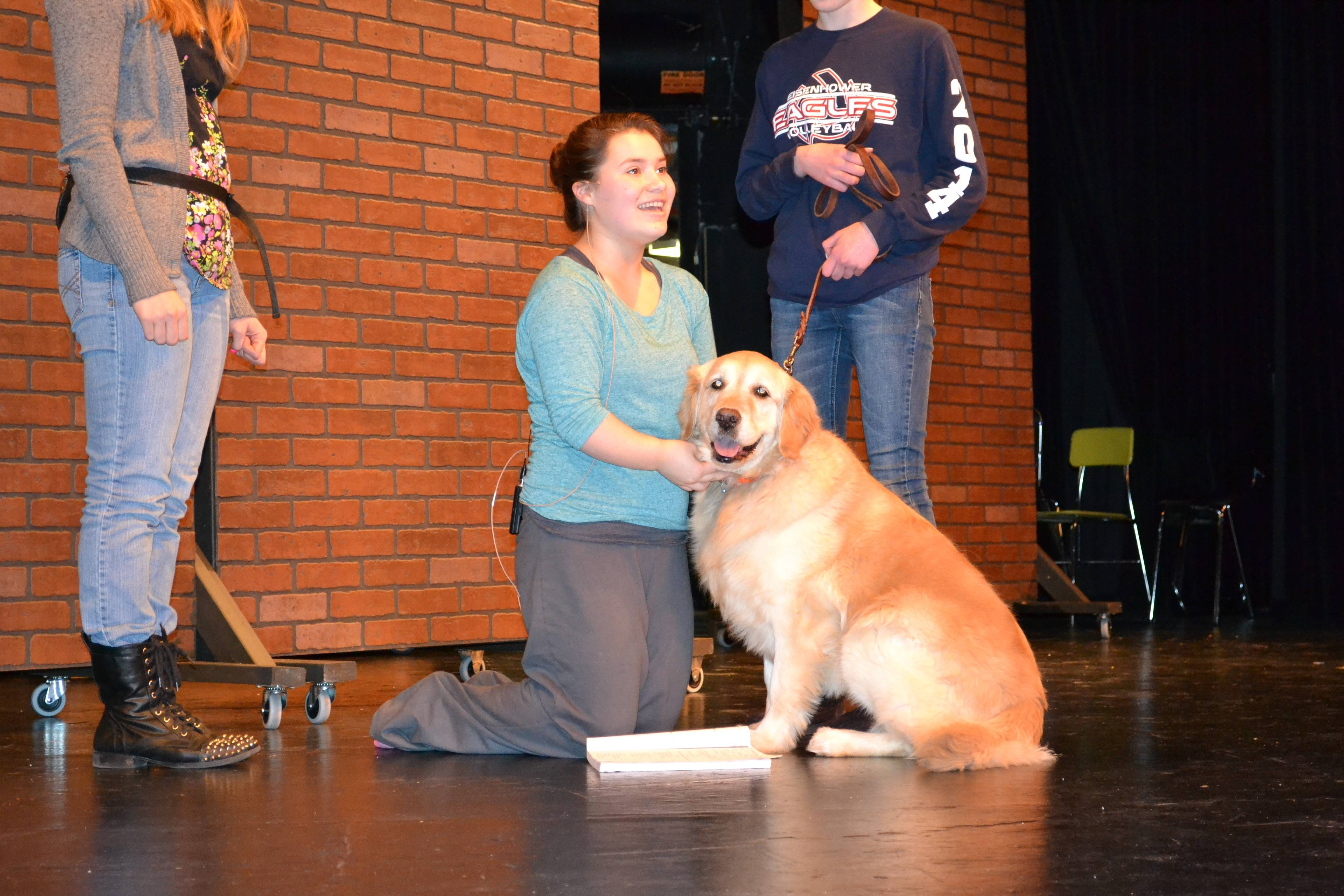 "Rebecca Fuscone (aka Annie) and her dog Sandy rehearse for Hoffman Estates High School's production of ""Annie,"" being staged March 7 and 8 and 13-15, at the school."