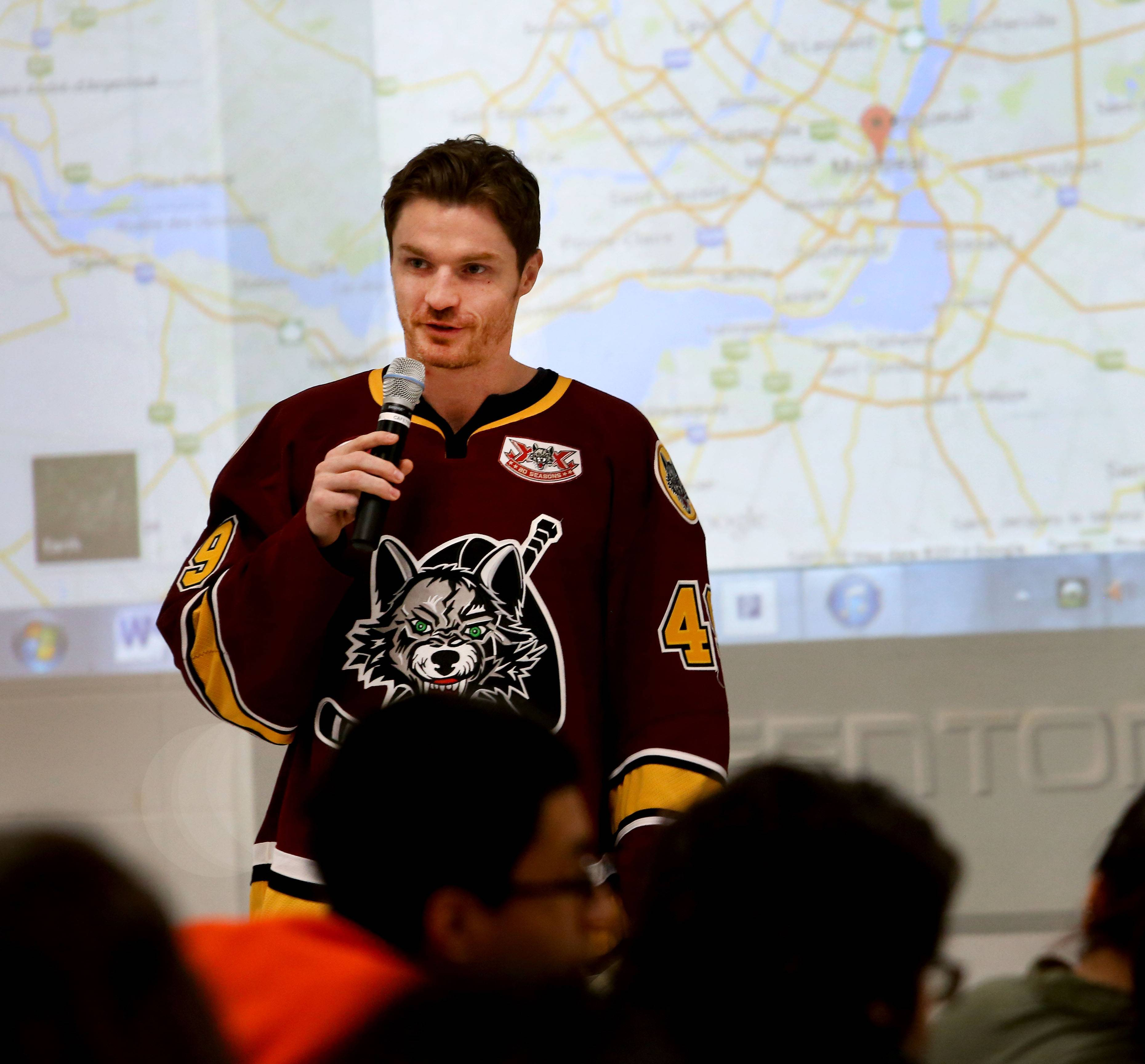 Alexandre Bolduc, a center for the Chicago Wolves, answers questions in French Wednesday during an appearance at Fenton High School.