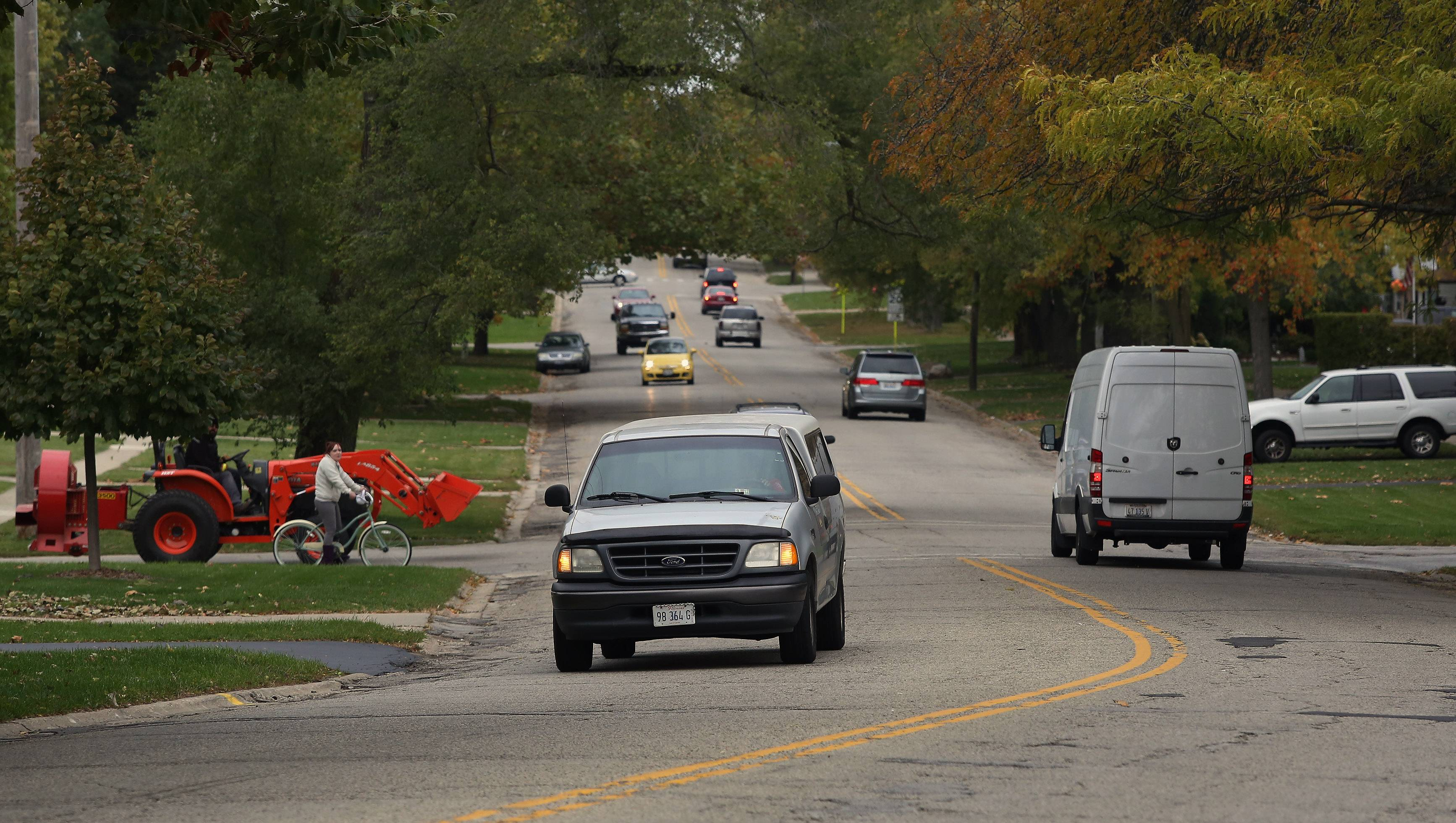 Traffic moves along Hawley Street in Mundelein in this file photo. Officials want to widen and repave the road.