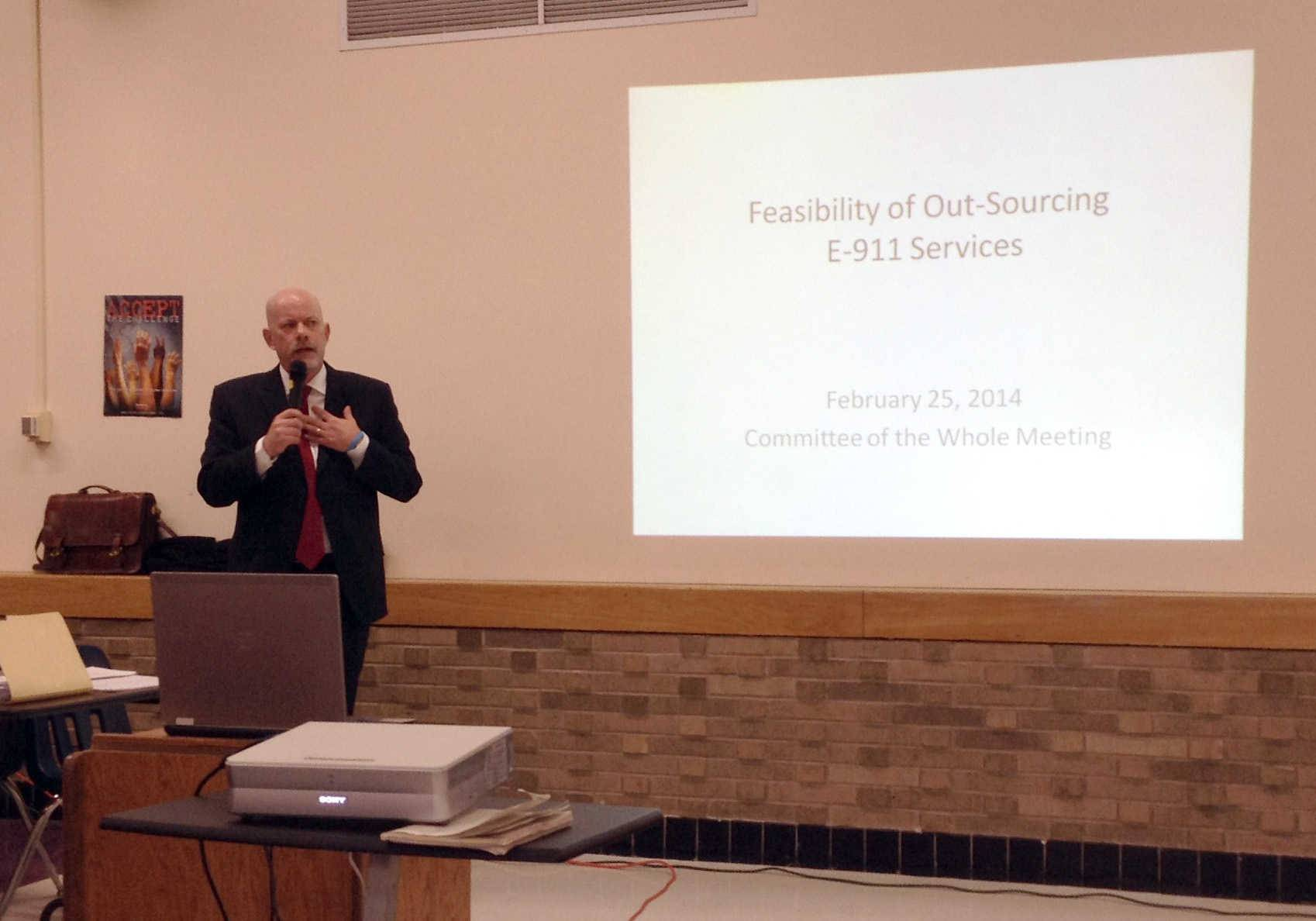 Wauconda Village Administrator Doug Maxeiner talks about the possible outsourcing of 911 services during a village board meeting Tuesday at the local high school.