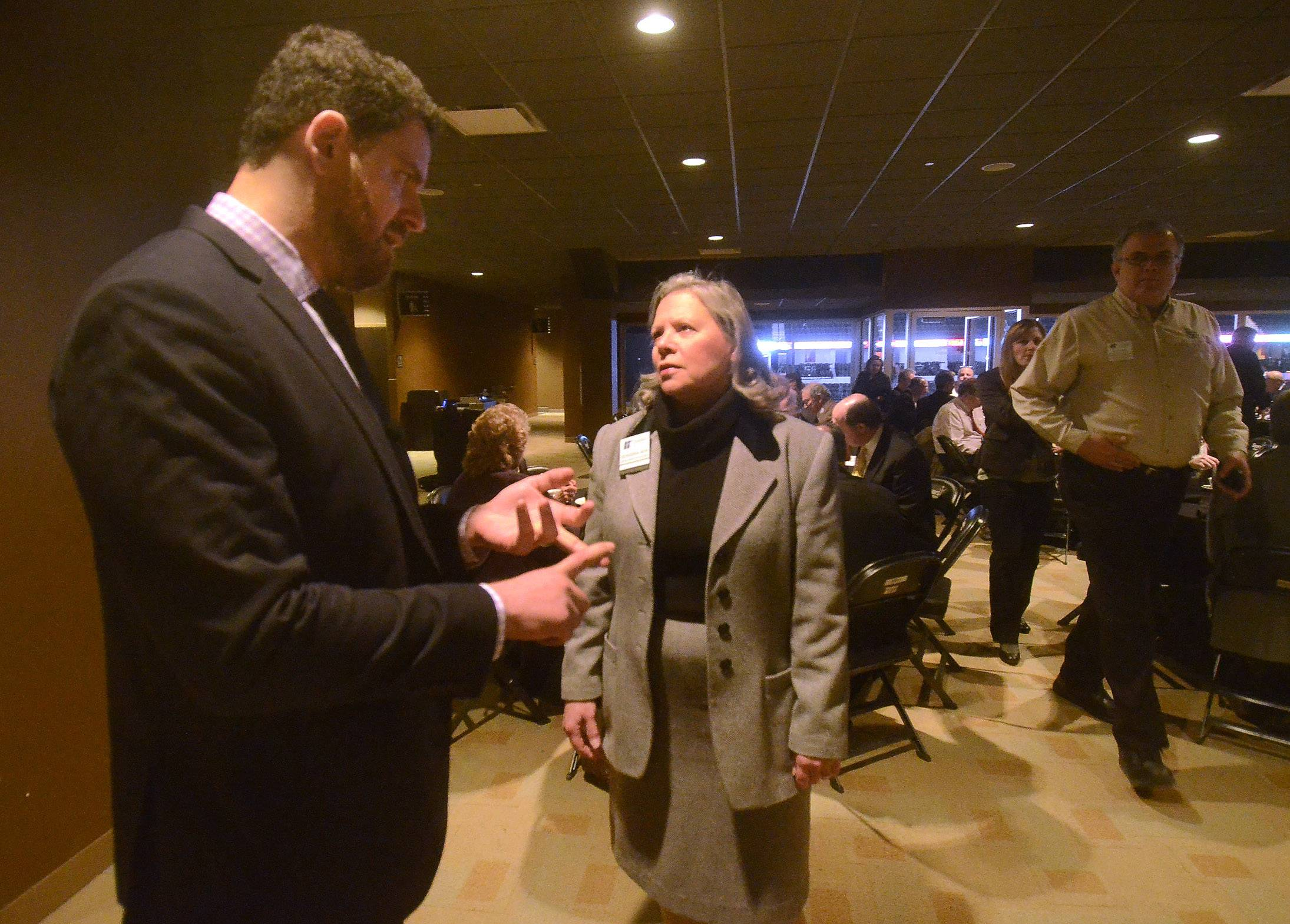 Sears Centre General Manager Ben Gibbs talks with Georgeanna Mehr, president of Hoffman Estates Community Bank, before Hoffman Estates Mayor Bill McLeod's Community Update breakfast Wednesday at the Sears Centre Arena Club.