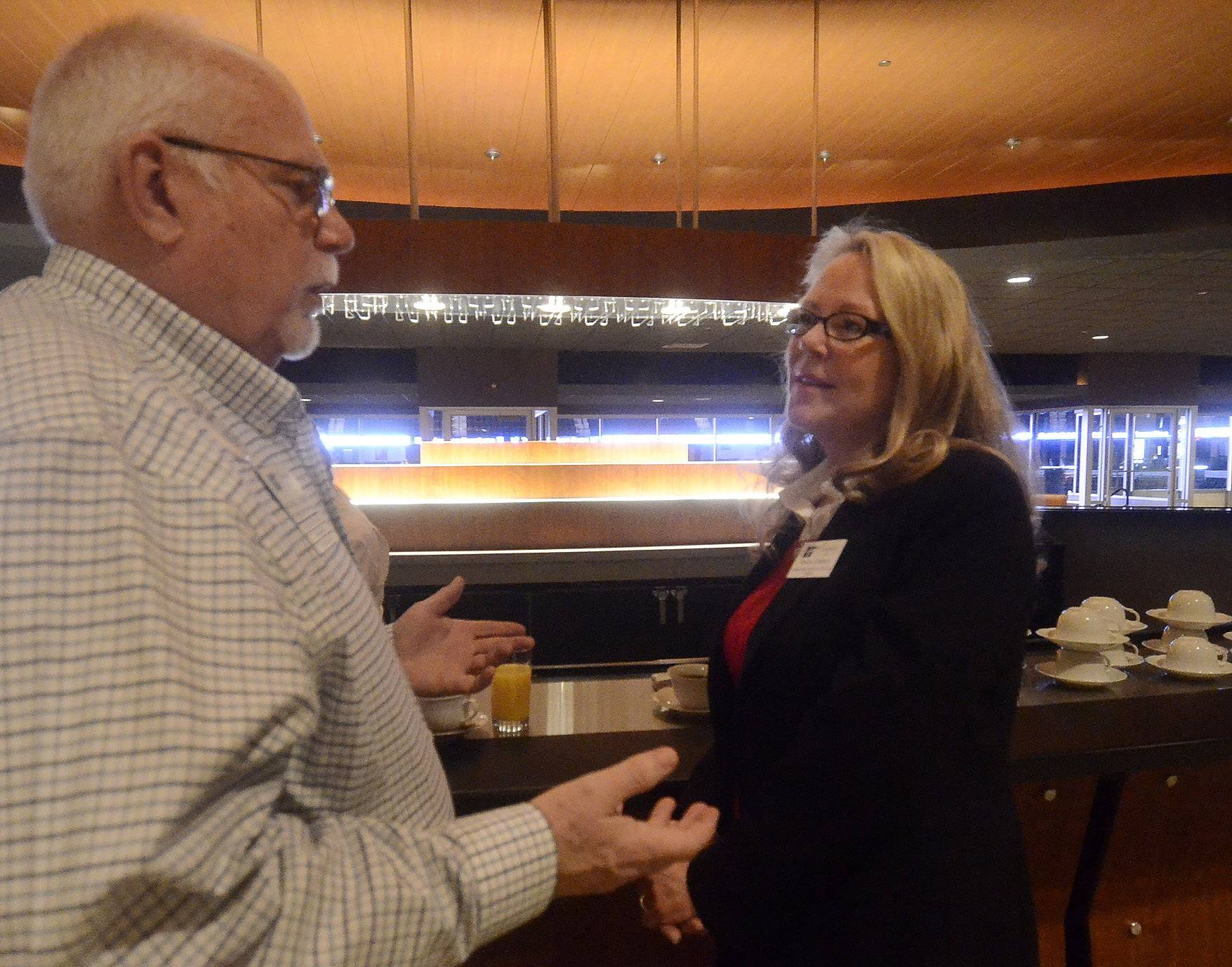 Mike Hanson of the Hoffman Estates Chamber of Commerce talks with Tricia O'Brien, president of the Hoffman Estates Chamber of Commerce, before Hoffman Estates Mayor Bill McLeod's Community Update breakfast Wednesday at the Sears Centre Arena Club.