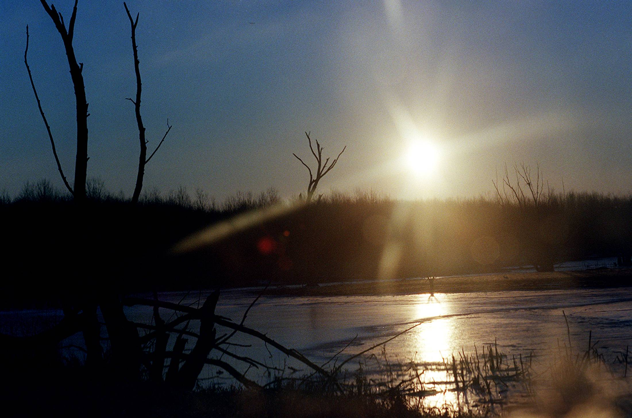 The sun rises over the frozen pond of Crabtree Nature Center near South Barrington.