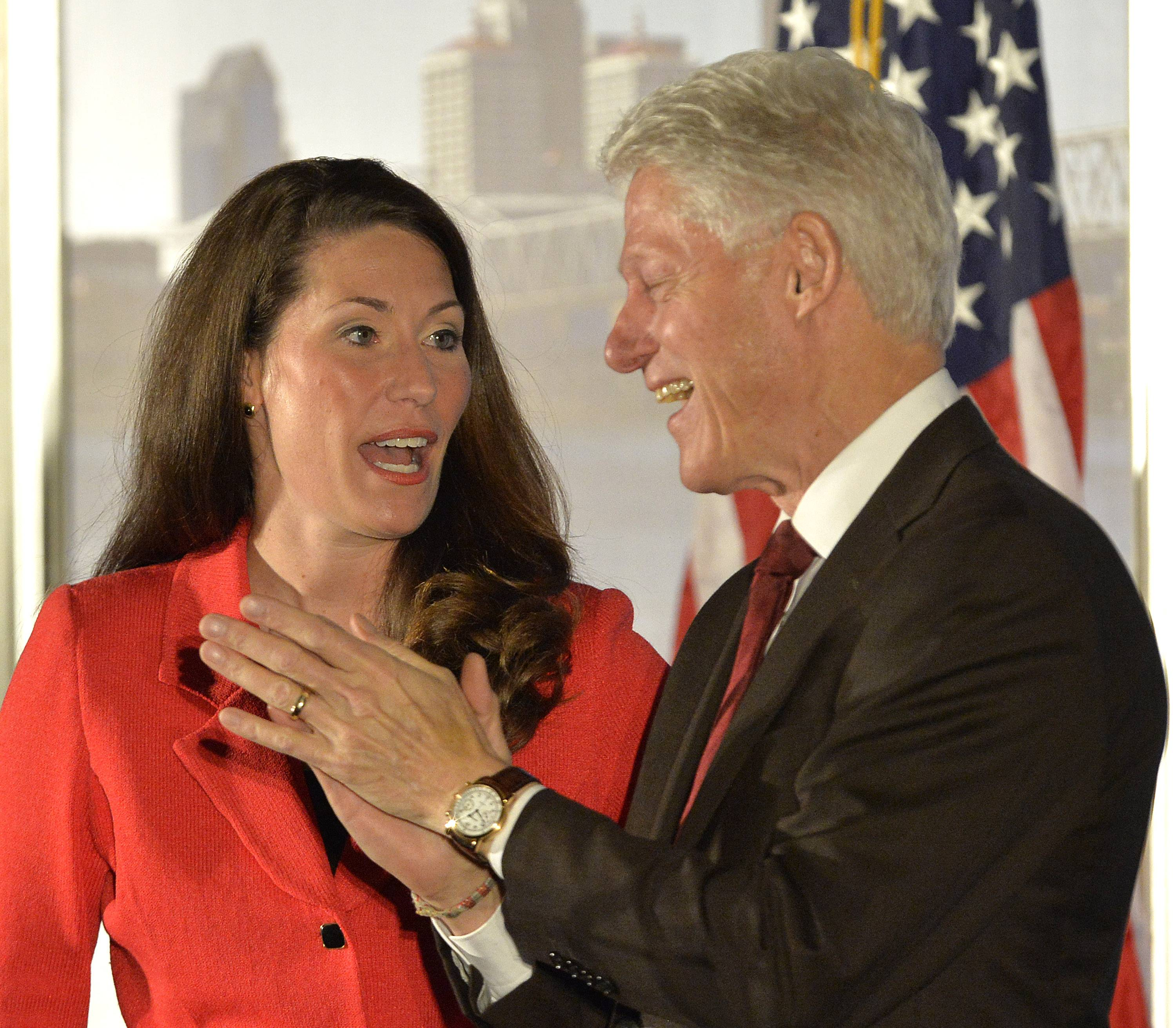 Democratic Senate challenger Alison Lundergan Grimes left, speaks with former President Bill Clinton as they are introduced at a fundraiser at the Galt House Hotel, Tuesday, Feb. 25, 2014, in Louisville, Ky.