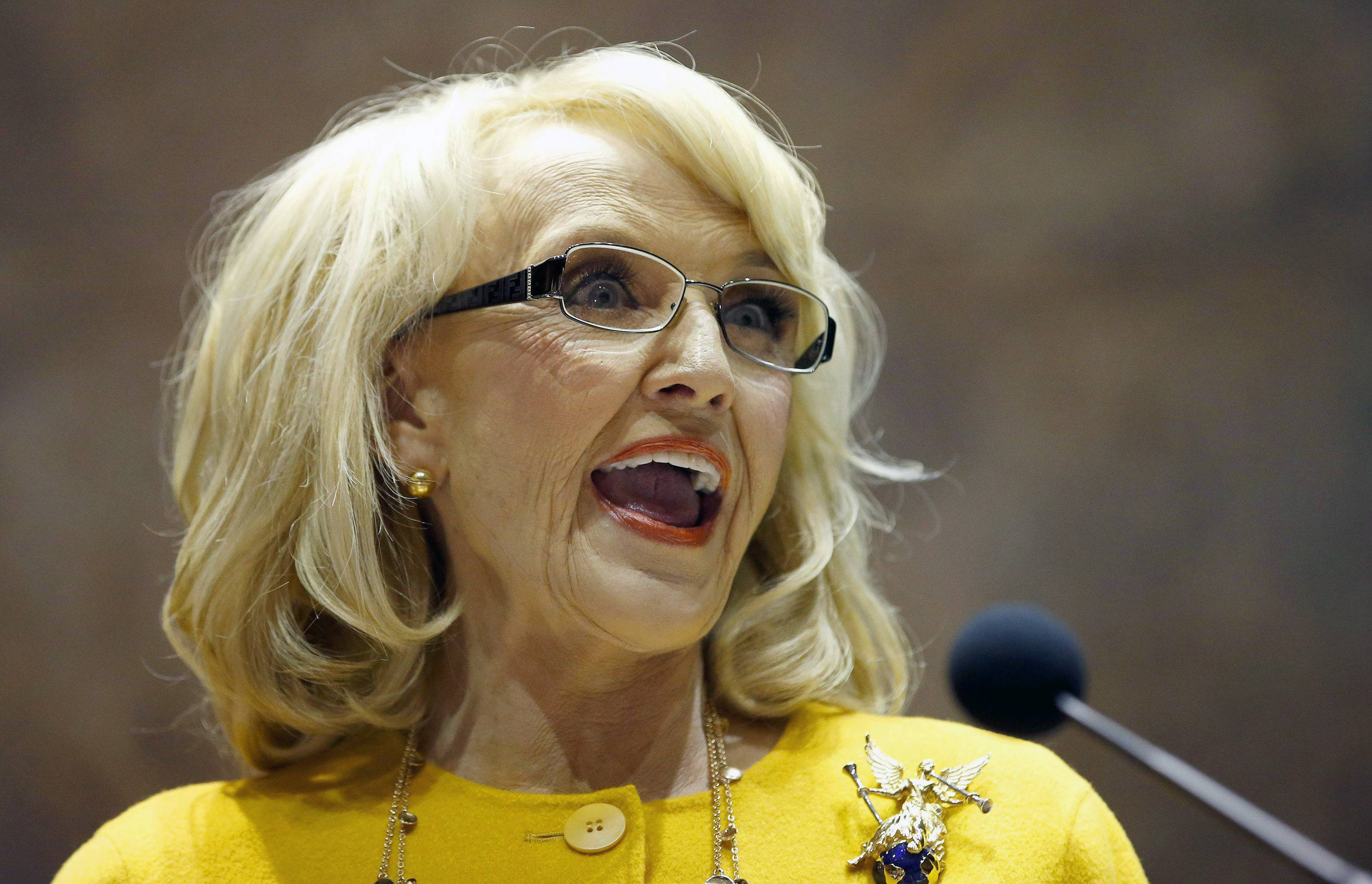 Arizona Gov. Jan Brewer bowed to intensifying pressure from CEOs, politicians in Washington and state lawmakers in her own party and vetoed a bill that would have allowed business owners with strongly held religious beliefs to deny service to gays and lesbians.