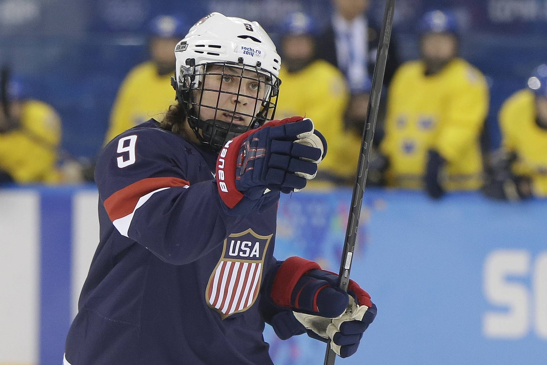 U.S. women's hockey team defenseman Megan Bozek, a Buffalo Grove native and Stevenson High School graduate, celebrates her goal against Sweden during second period of semifinal game Feb. 17 in the Sochi Winter Olympics.