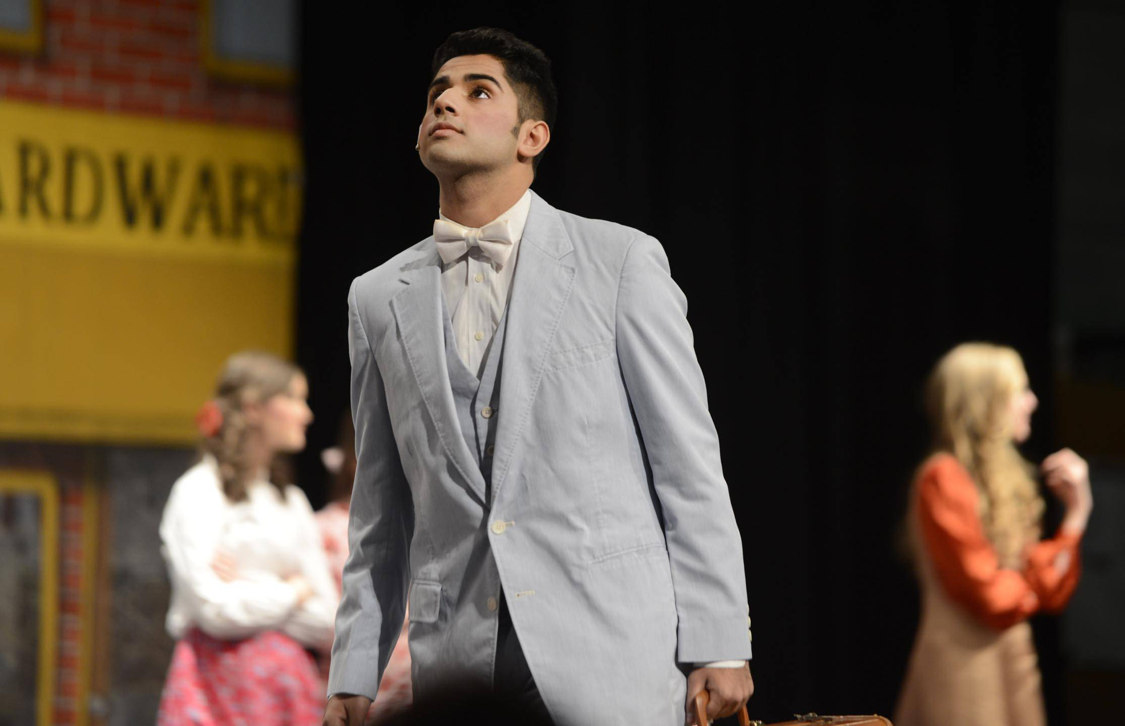 "Reza Kahn rehearses the lead role of Harold Hill in the Elgin High School production of ""The Music Man."""