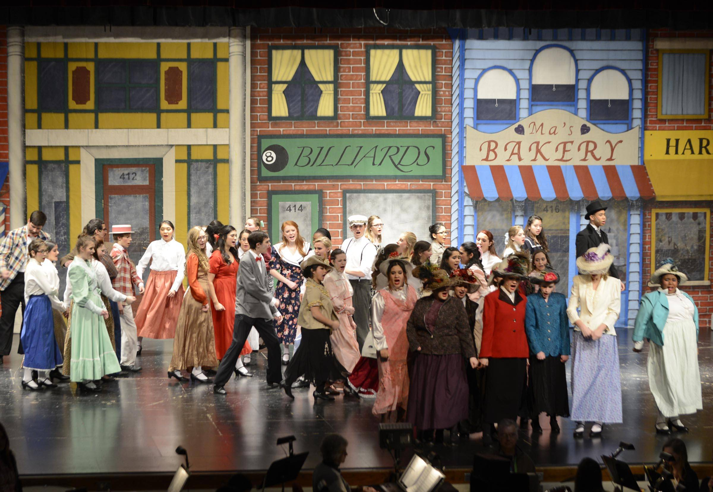 "The cast sings onstage during a rehearsal of Elgin High School's production of ""The Music Man."""