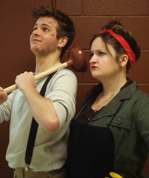 "Colin Bokowy plays Bobby Strong and Katie Conomikes plays Penelope Pennywise in Jacobs High School's production of ""Urinetown: the Musical."""