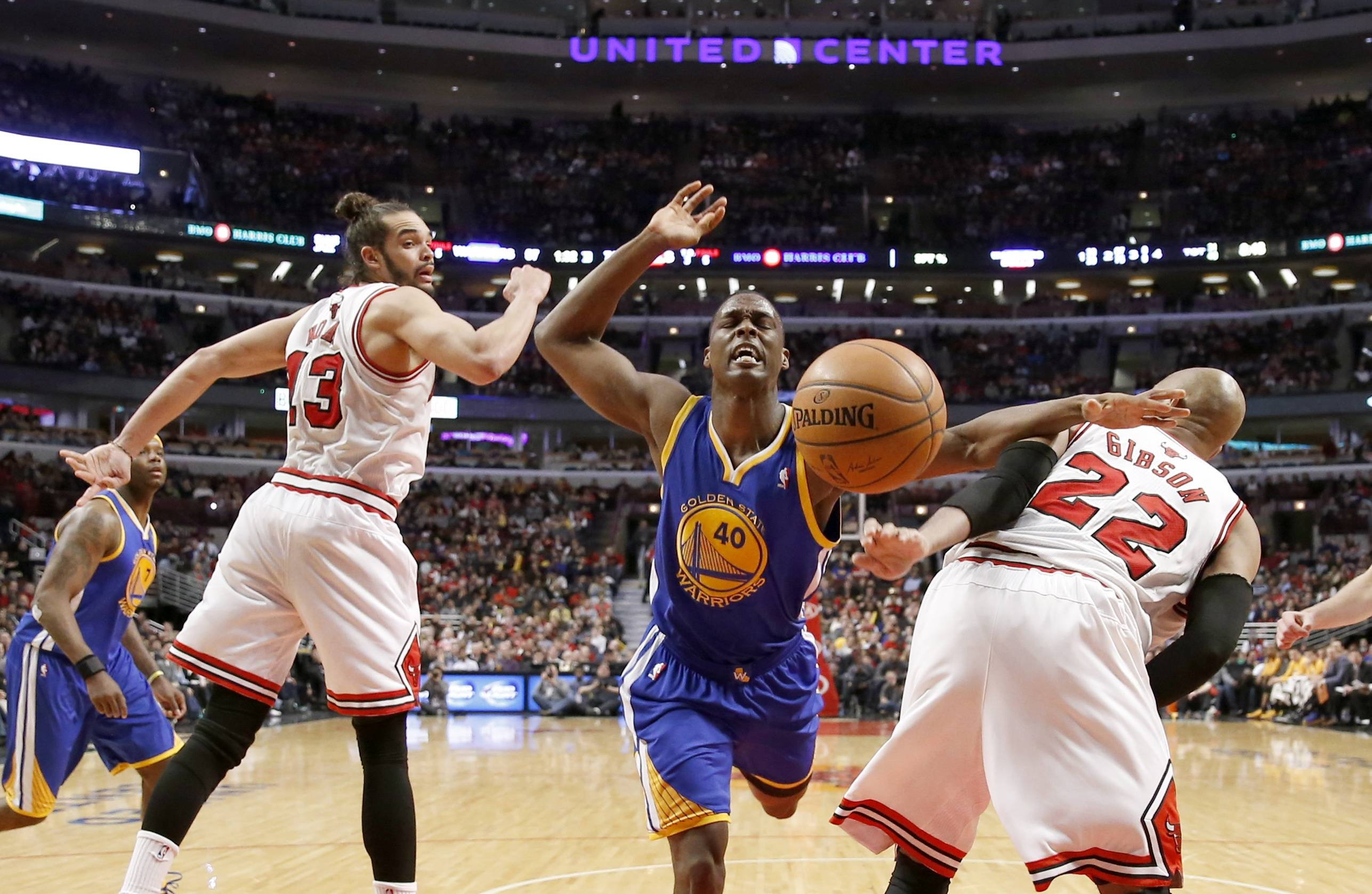 Golden State Warriors' Harrison Barnes has the ball stripped away by Bulls forward Taj Gibson (22) as Joakim Noah (13) also defends Wednesday during the second half at the United Center. The Bulls won 103-83.