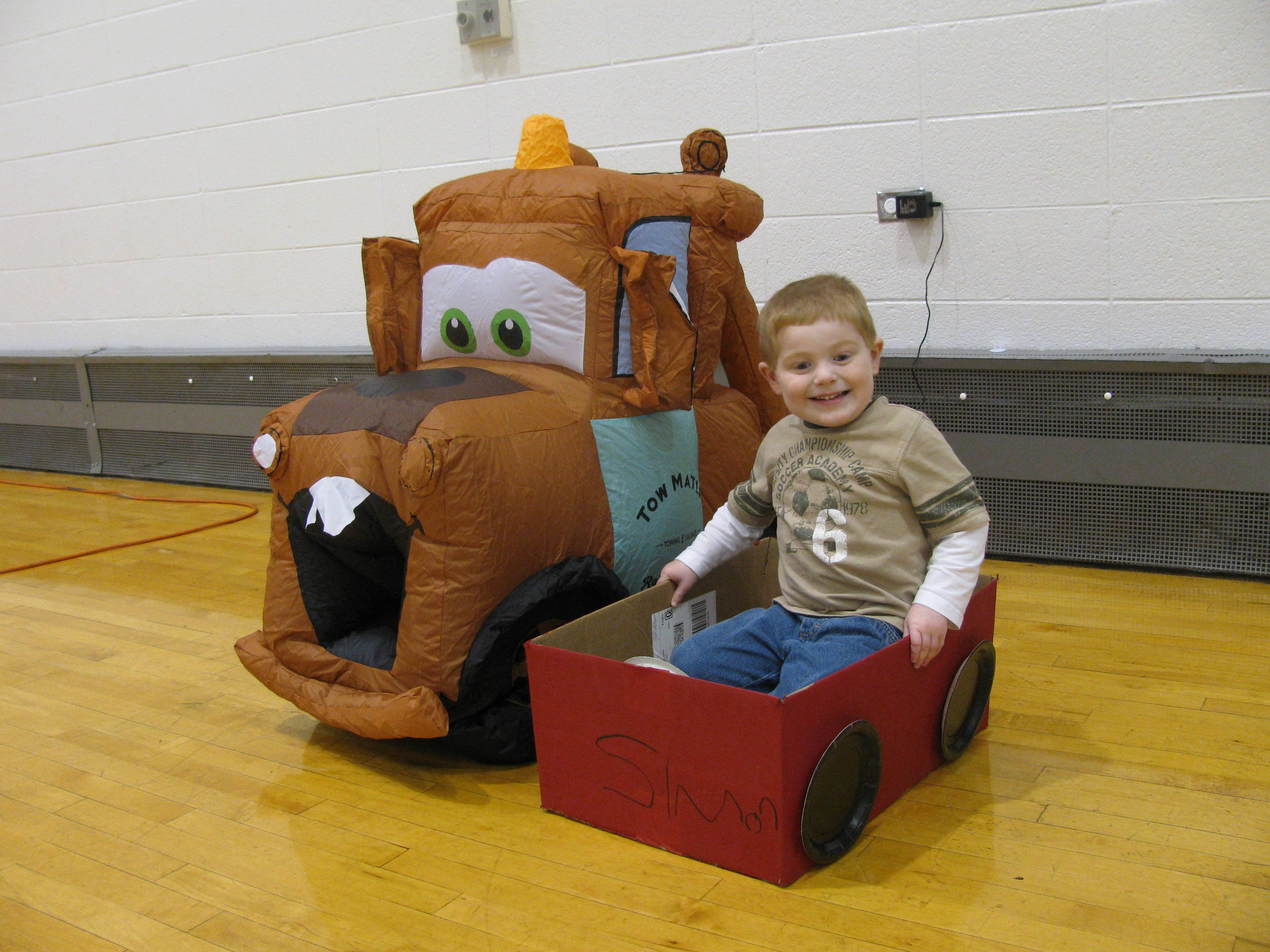A participant enjoys the car he made at a previous indoor drive in movie night.Palatine Park District